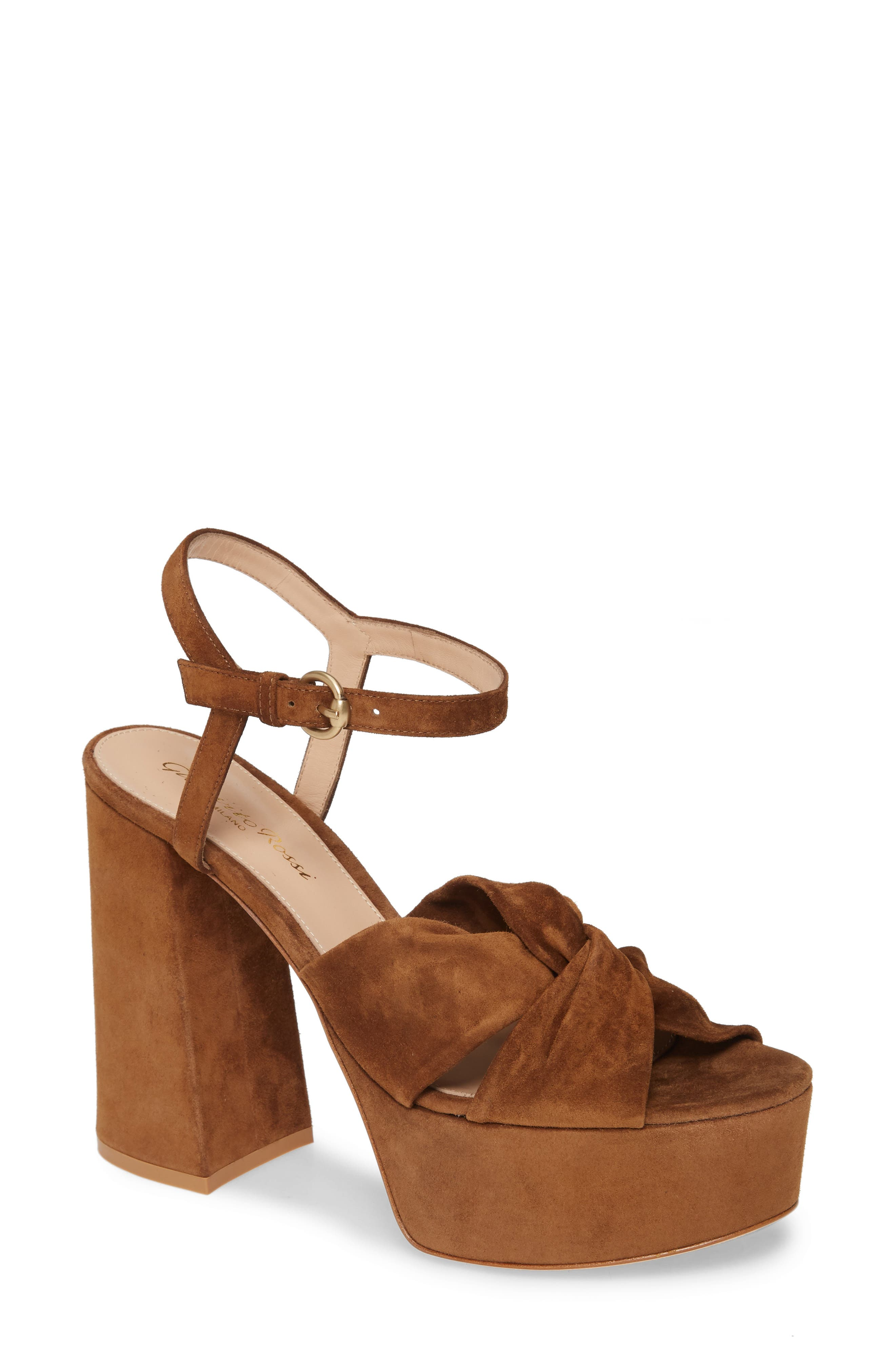 A towering flared heel and platform lend major \'70s-inspired style to an Italian-made sandal featuring softly knotted straps. Style Name: Gianvito Rossi Donna Platform Sandal (Women). Style Number: 5919834. Available in stores.