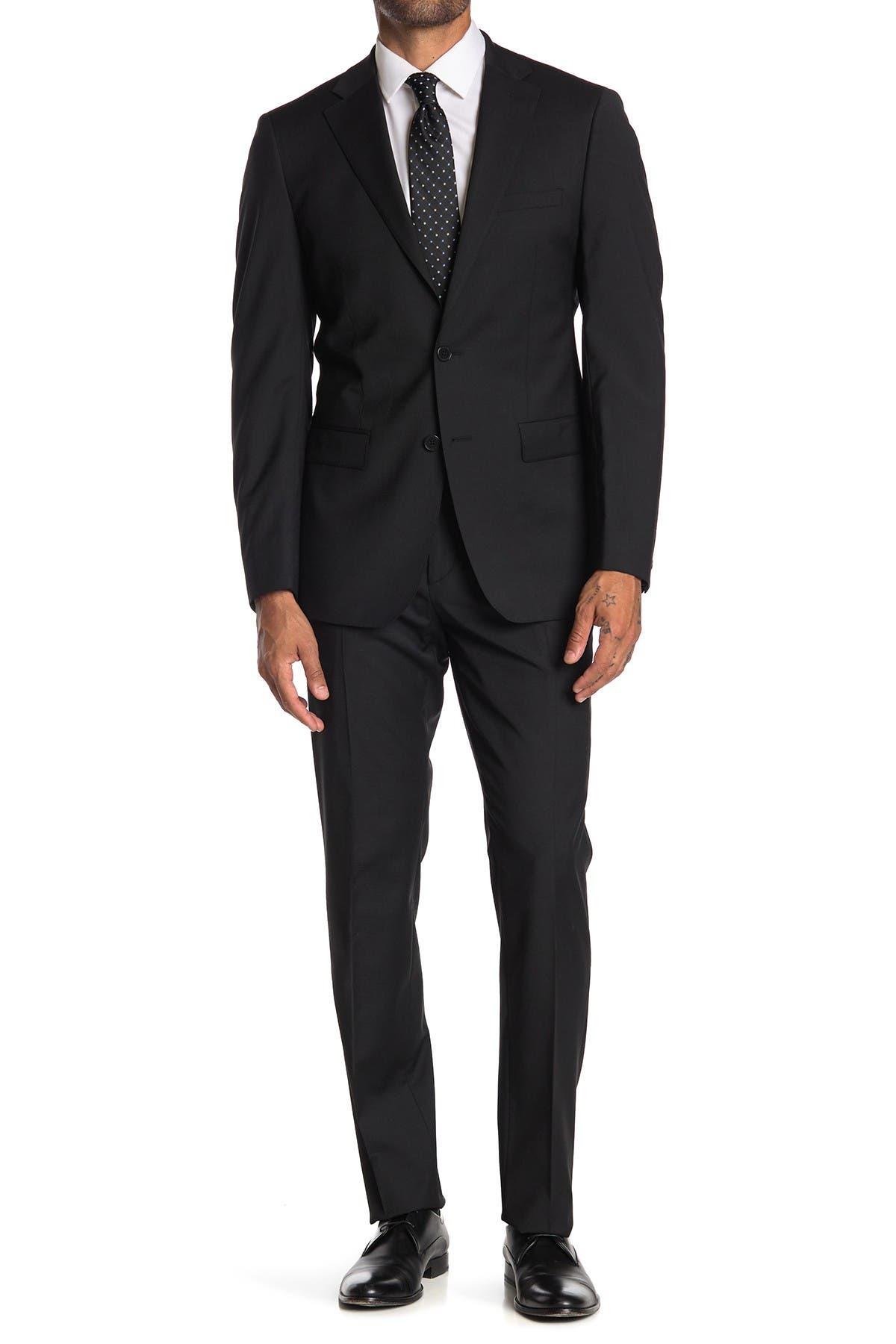 Image of Calvin Klein Solid Black Two Button Notch Lapel Suit