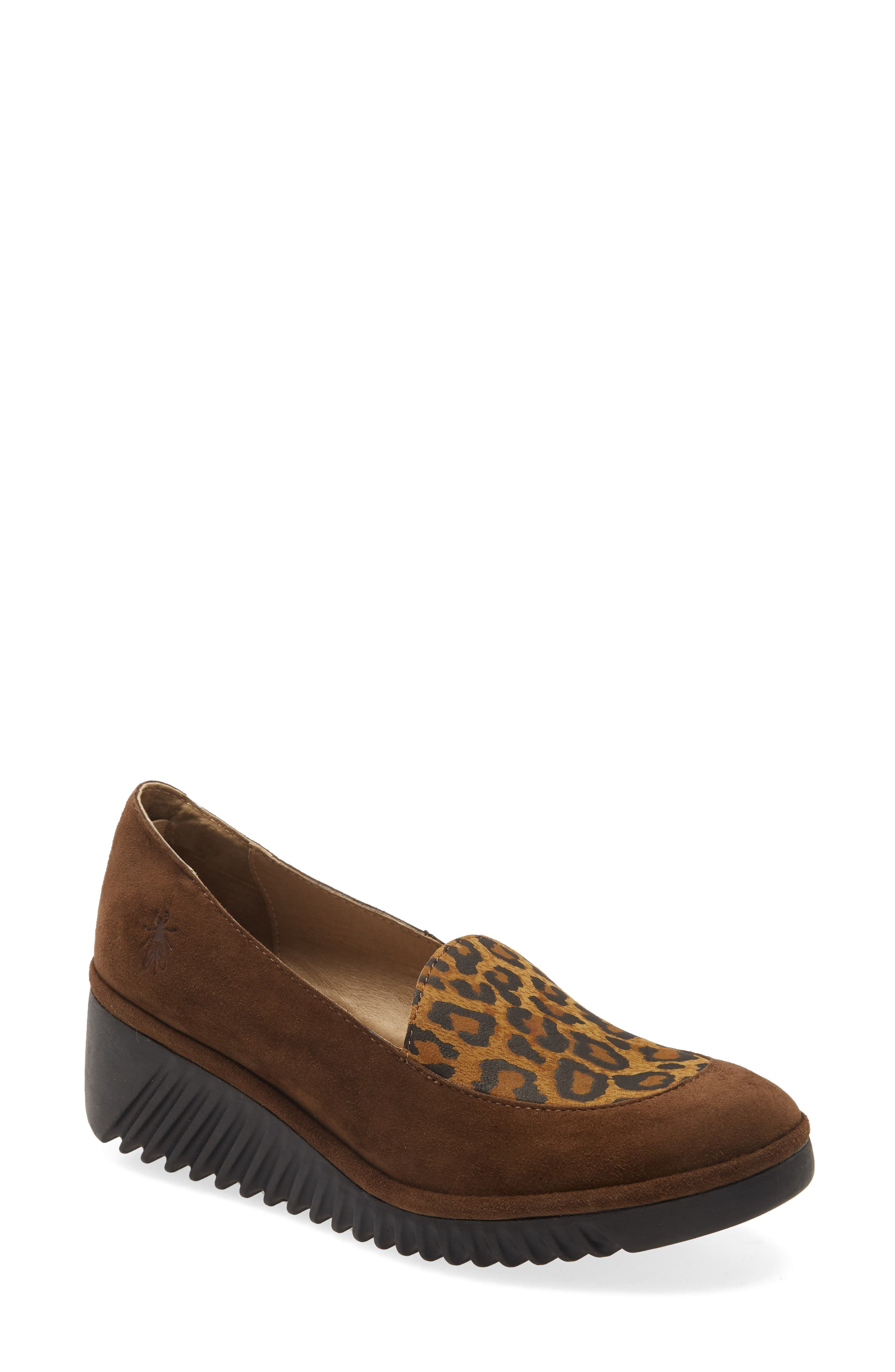 A waved, flexible wedge sole heightens the contemporary style of this versatile leather loafer fitted with a cushioned footbed. Style Name: Fly London Luan Wedge Loafer (Women). Style Number: 6094454. Available in stores.