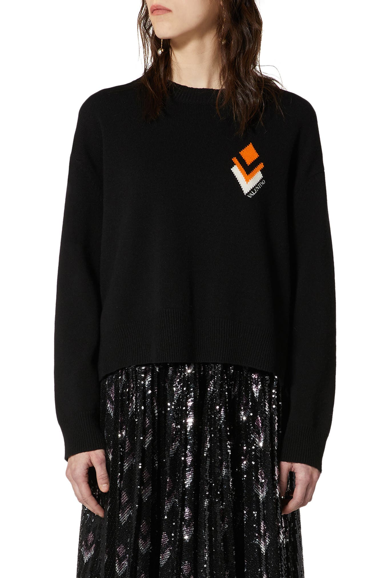 An intarsia arrow design and embroidered logo bring sharp style to an ultra-soft and cozy oversized sweater knit from a blend of virgin wool and cashmere. Style Name: Valentino Arrow Logo Oversize Wool & Cashmere Sweater. Style Number: 6013649. Available in stores.