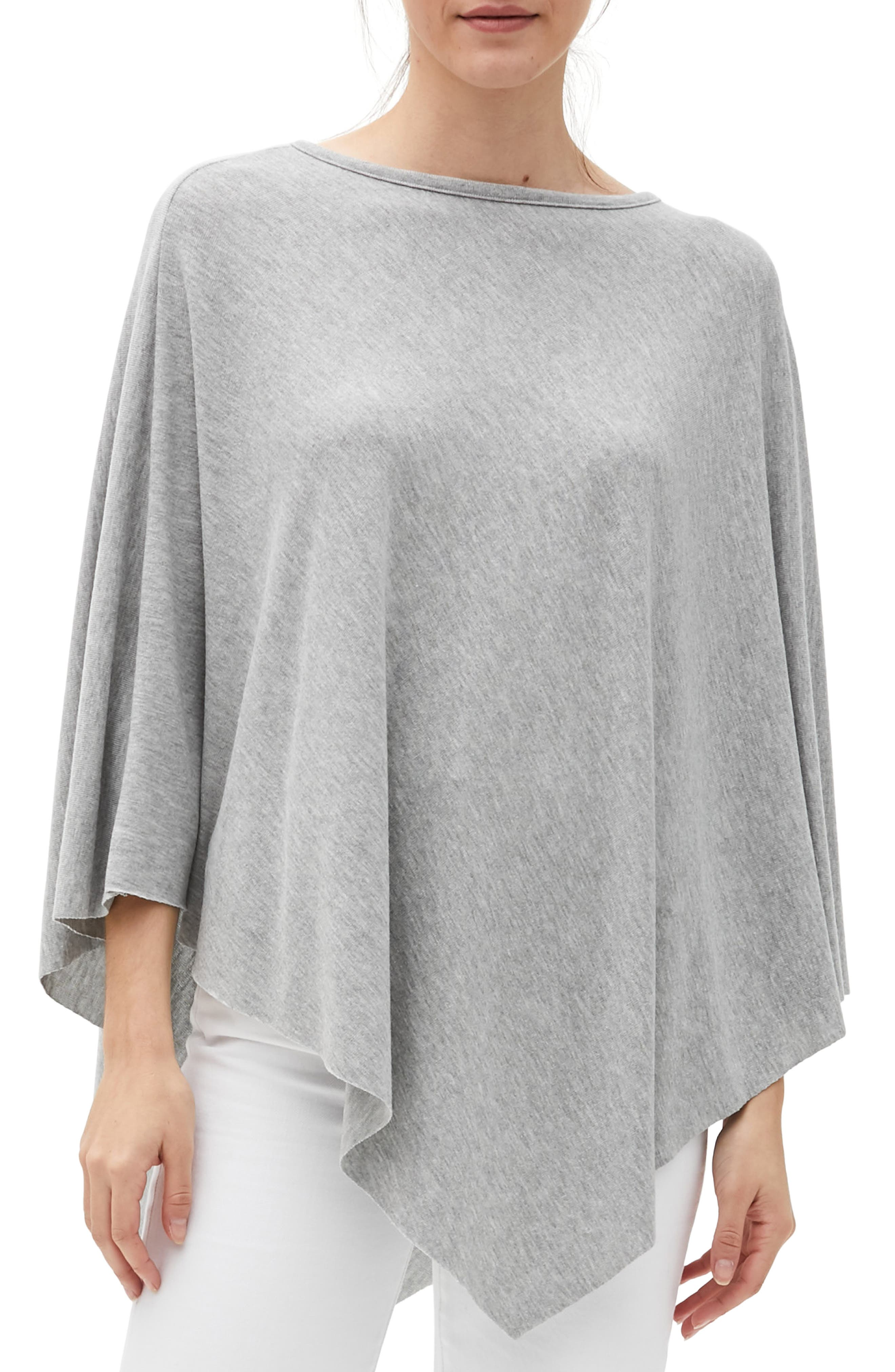Feel the warmth of this soft poncho designed in an elegant drape with a chic asymmetrical hem. Style Name: Michael Stars Persephone Boat Neck Poncho. Style Number: 6111123. Available in stores.