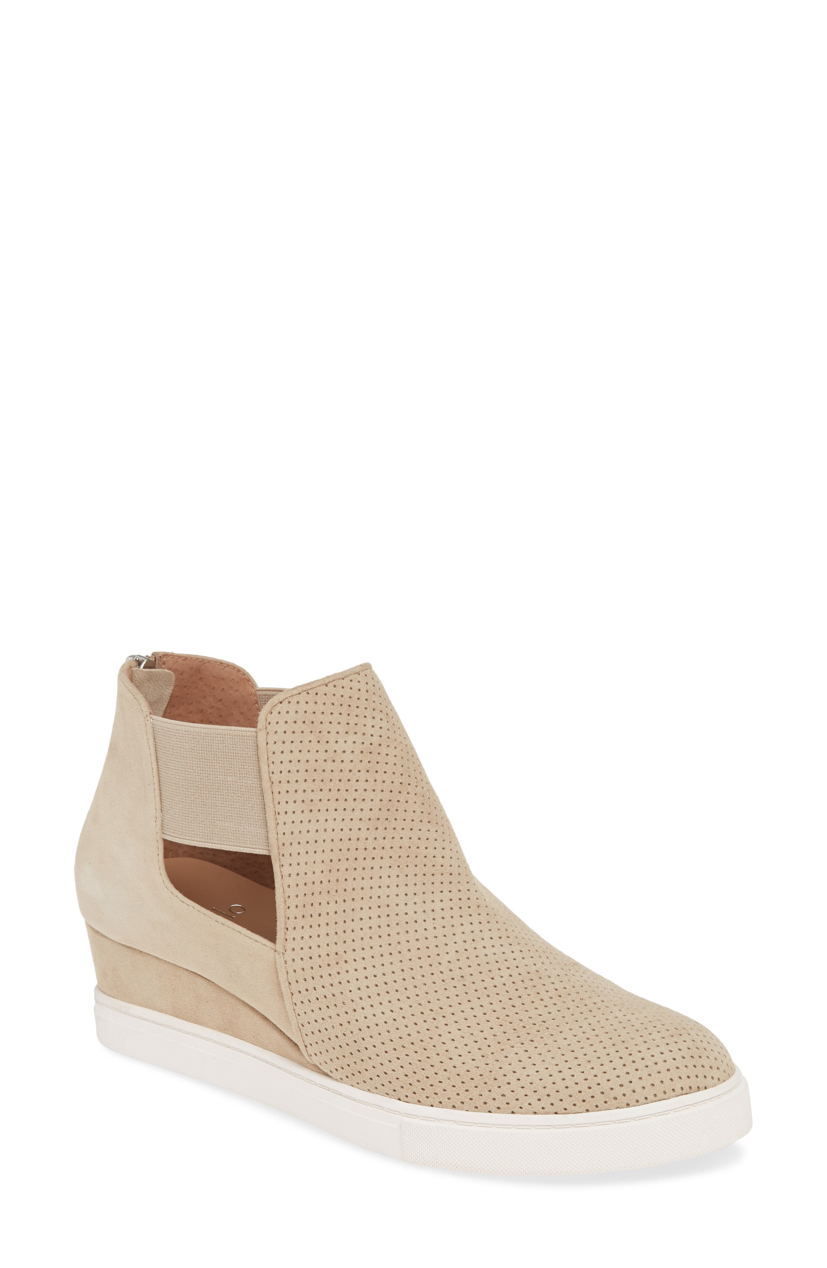 A crisp platform sole grounds a sporty-chic bootie featuring breezy perforations and elasticized straps above the cutouts at the sides. Style Name: Linea Paolo Amanda Slip-On Wedge Bootie (Women). Style Number: 5798233. Available in stores.