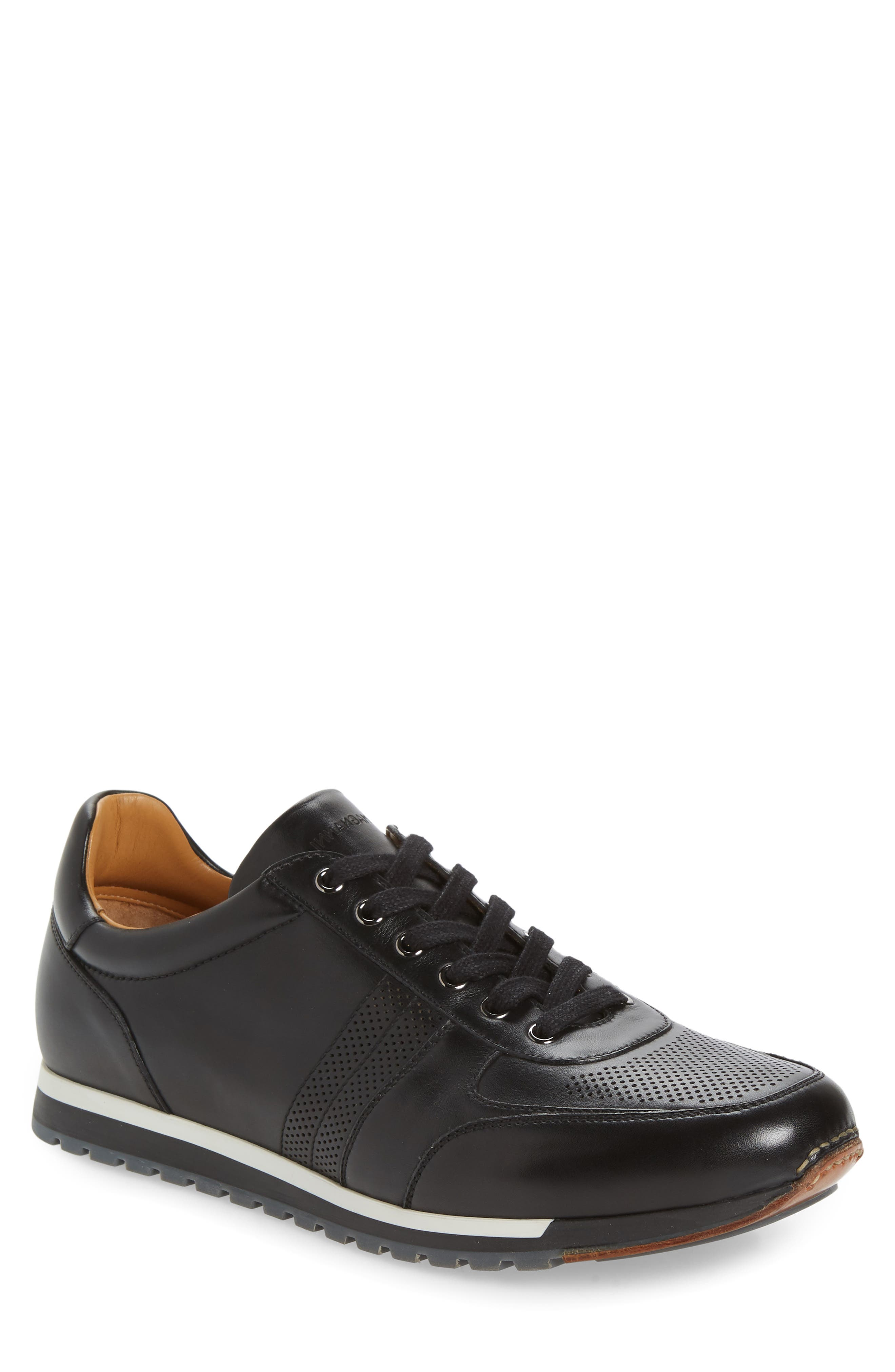 Neat dot perforations punctuate the toe and the angled racing stripes of a jet-black leather sneaker that sports a pop of white sandwiched into the sole. Style Name: Magnanni Lizandro Low Top Sneaker (Men). Style Number: 6019023. Available in stores.