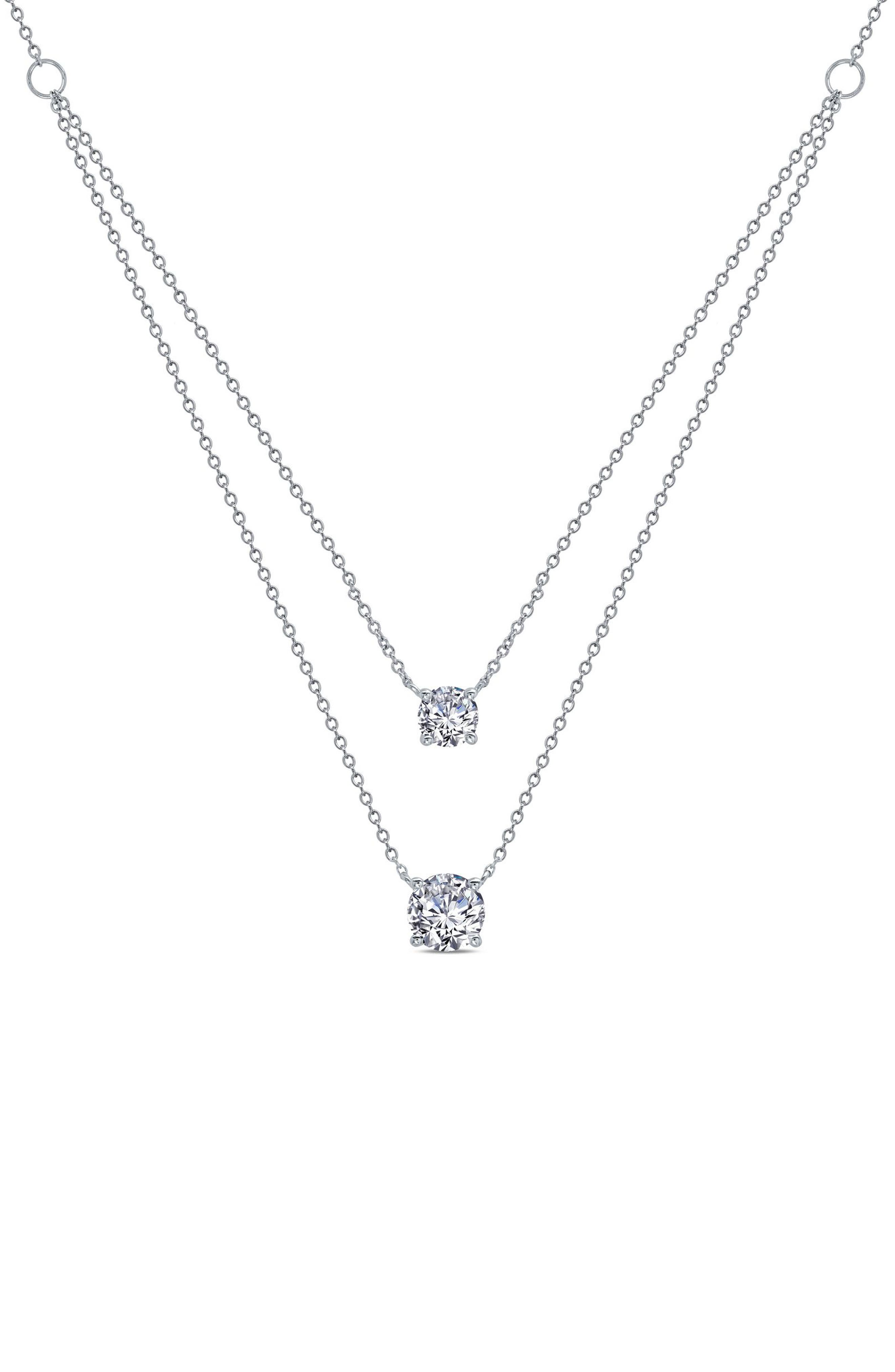 Slender chains suspend a pair of pendants set with sparkling simulated diamonds on this one-and-done layered necklace. Style Name: Lafonn Simulated Diamond Double Pendant Layered Necklace. Style Number: 6183408. Available in stores.