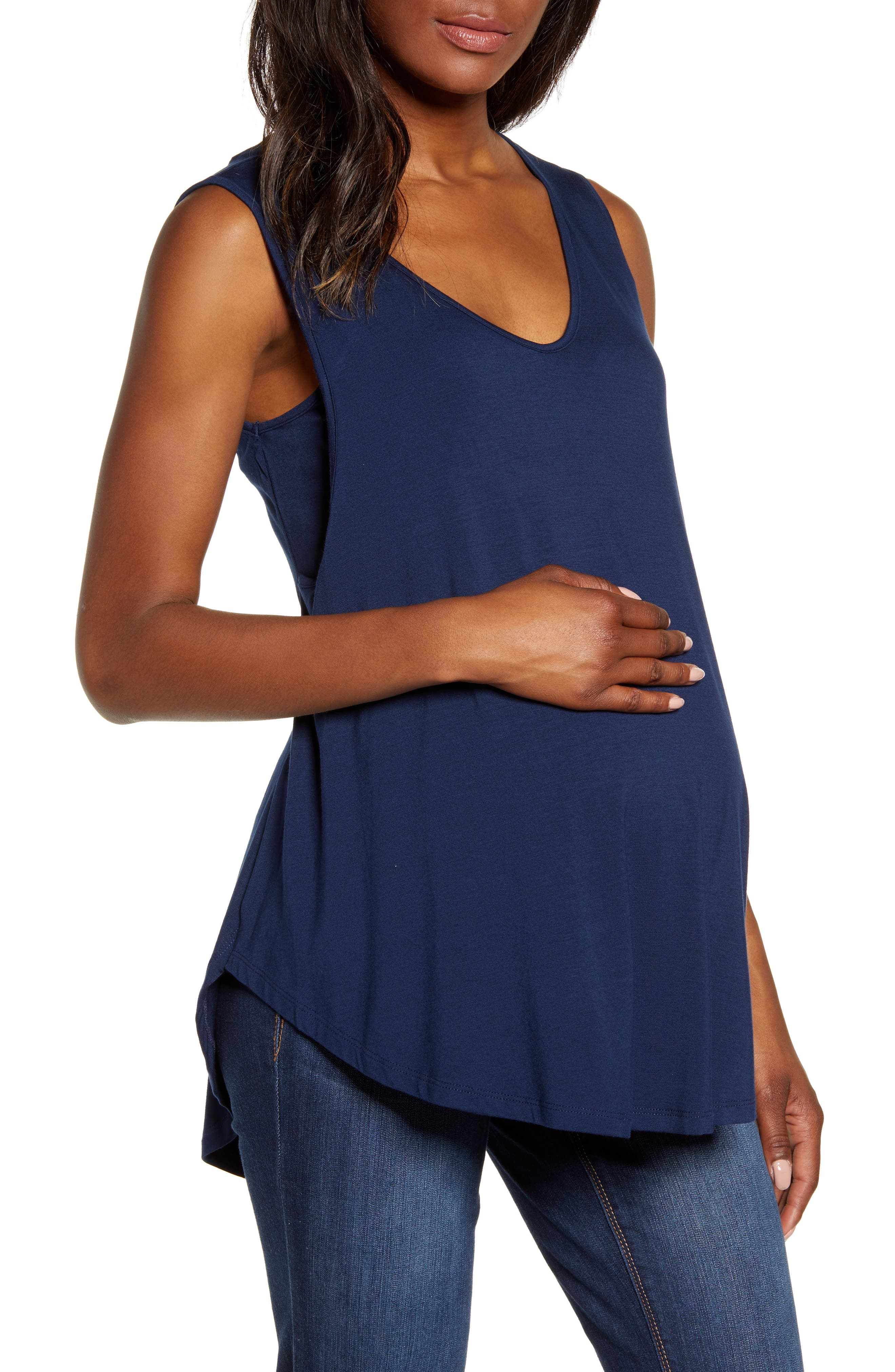 Keep cool on steamy days in this bump-friendly tank in a swingy silhouette designed with nursing panels for discreet access after baby arrives. Style Name: Angel Maternity Swing Maternity/nursing Tank. Style Number: 5852626. Available in stores.