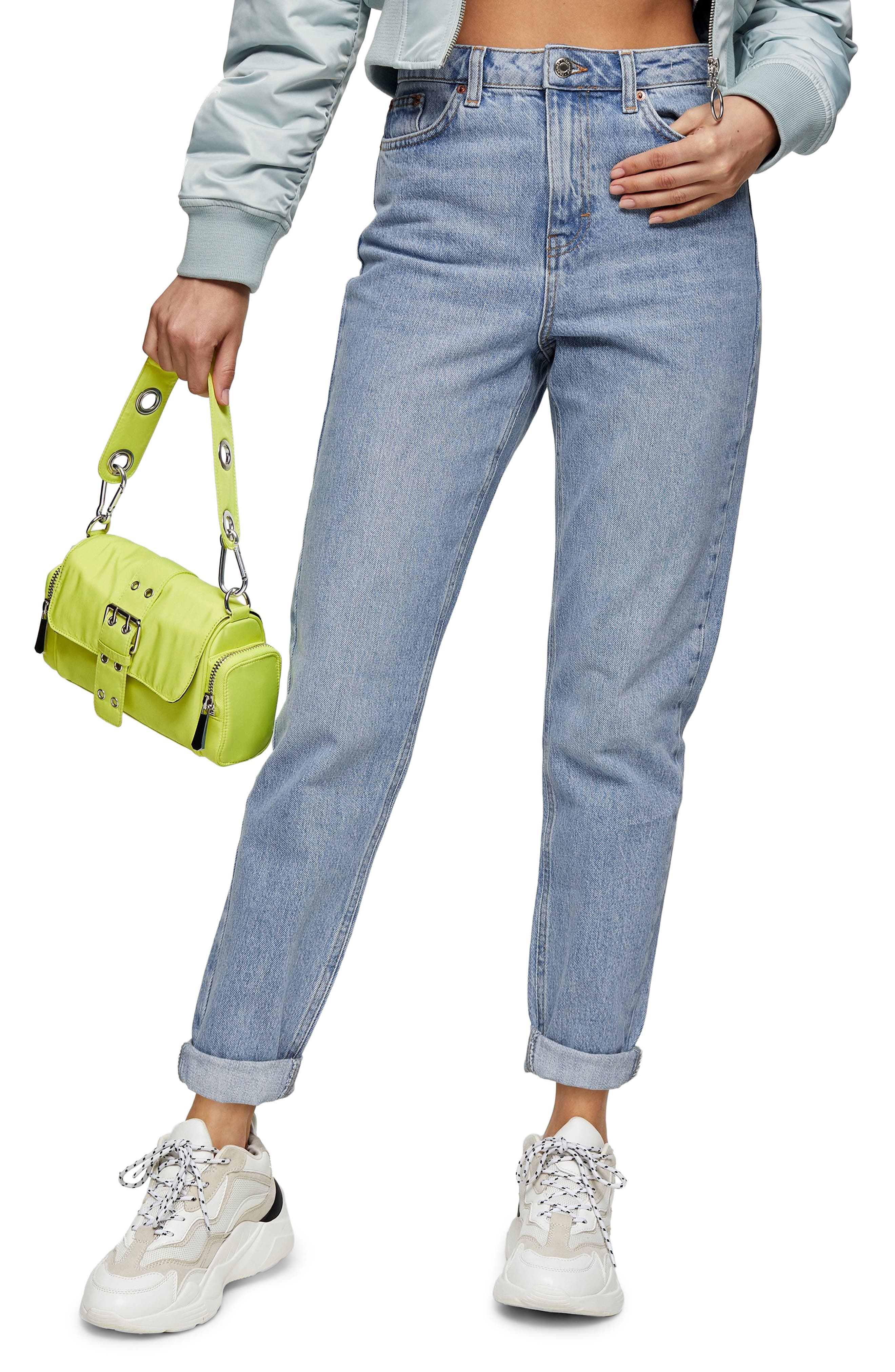 These modern mom jeans in nonstretch denim are finished in a perfectly bleached wash and cut with a high waist and tapered ankle-length cuffs. Style Name: Topshop Bleach Mom Jeans. Style Number: 5971631. Available in stores.