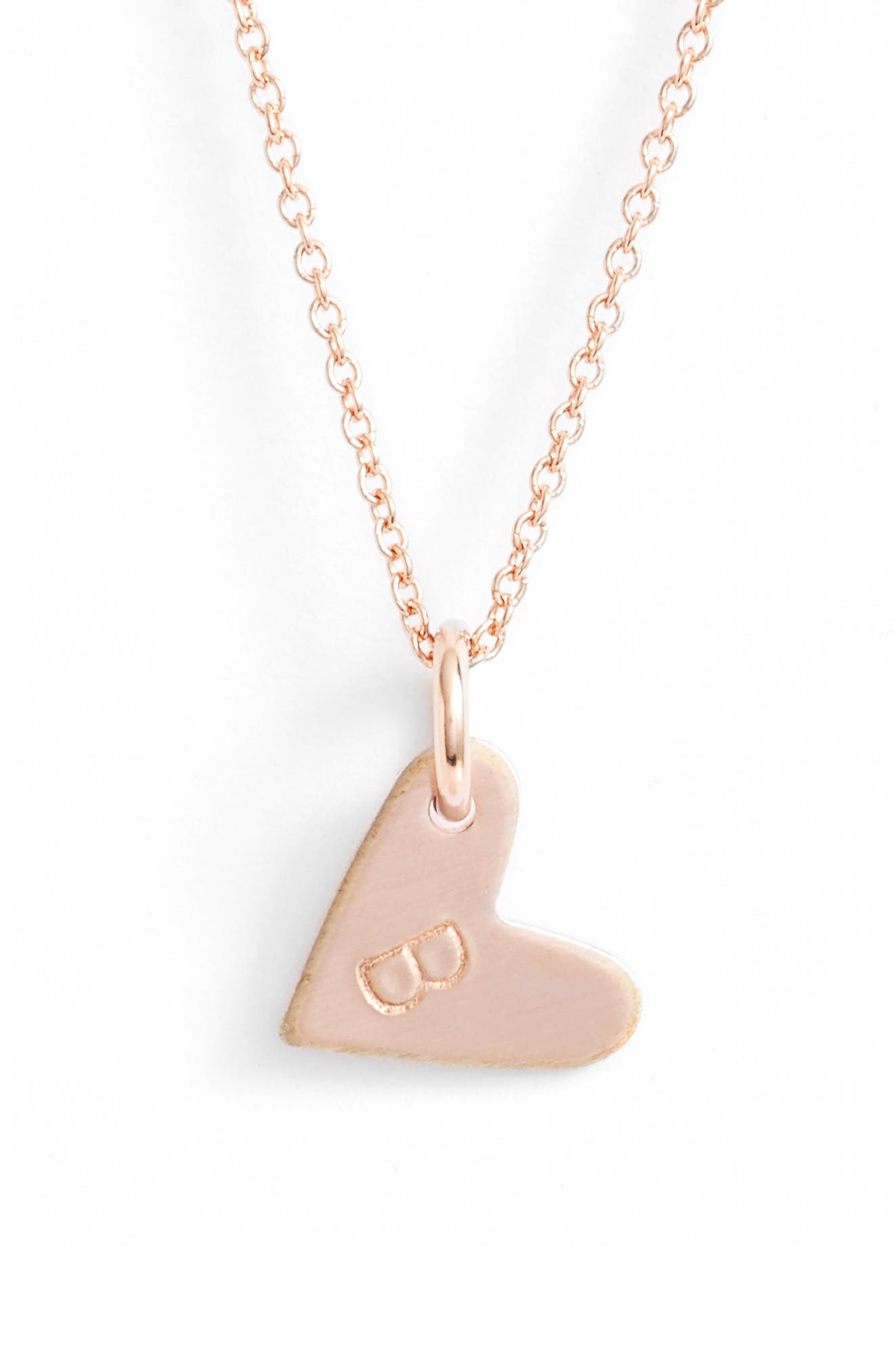 From humble beginnings to a fully staffed warehouse in Bend, Oregon, Nashelle remains true to its original purpose-handmade jewelry crafted with love and intention. A hand-stamped initial details a charming heart pendant that hangs from a chain-link necklace. Style Name: Nashelle Initial Heart Pendant Necklace. Style Number: 5143632. Available in stores.
