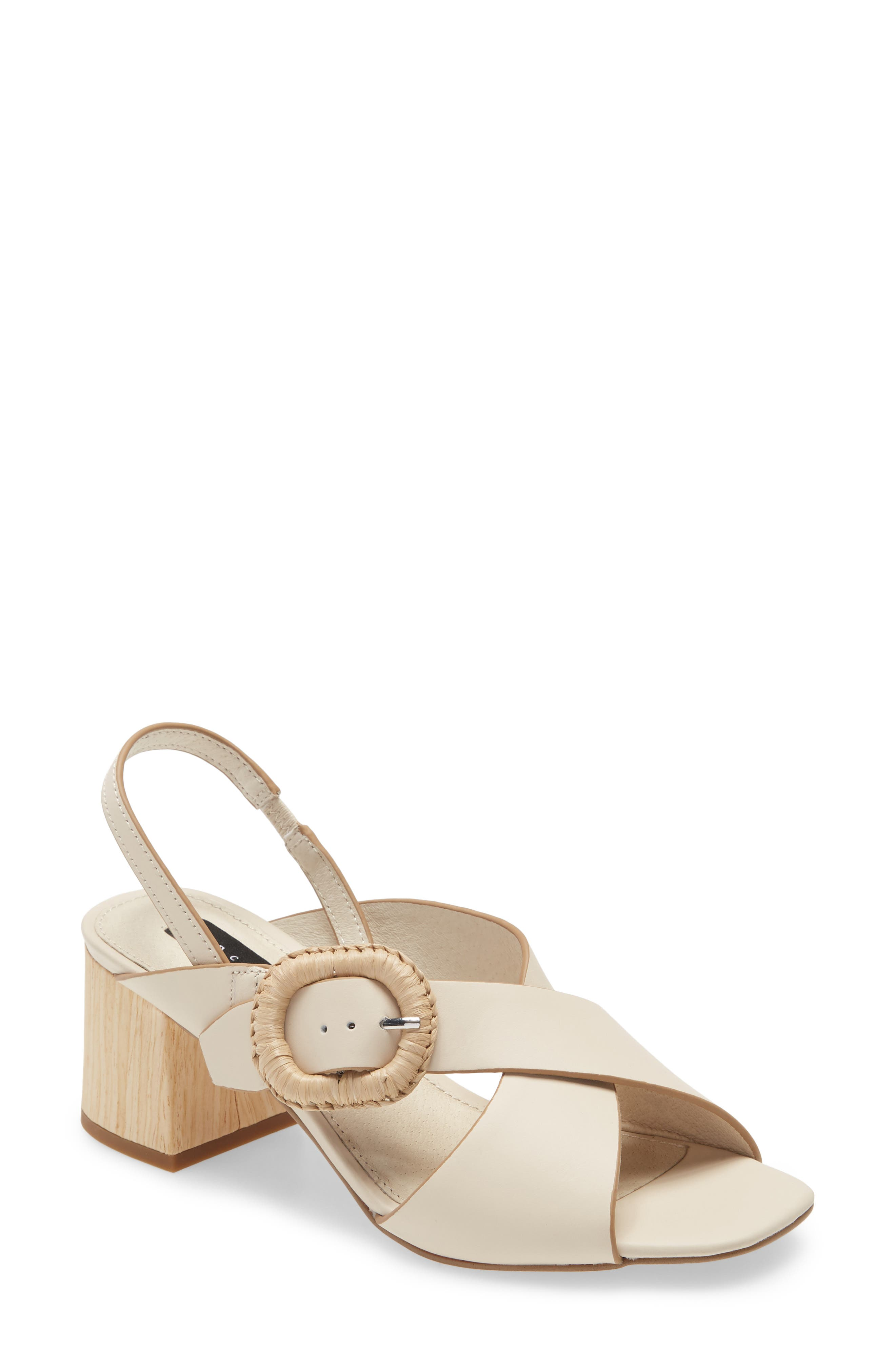 An oversized buckle details a strappy slingback sandal lifted by a woodgrain block heel. Style Name: Sanctuary Bounce Slingback Sandal (Women). Style Number: 6043019. Available in stores.