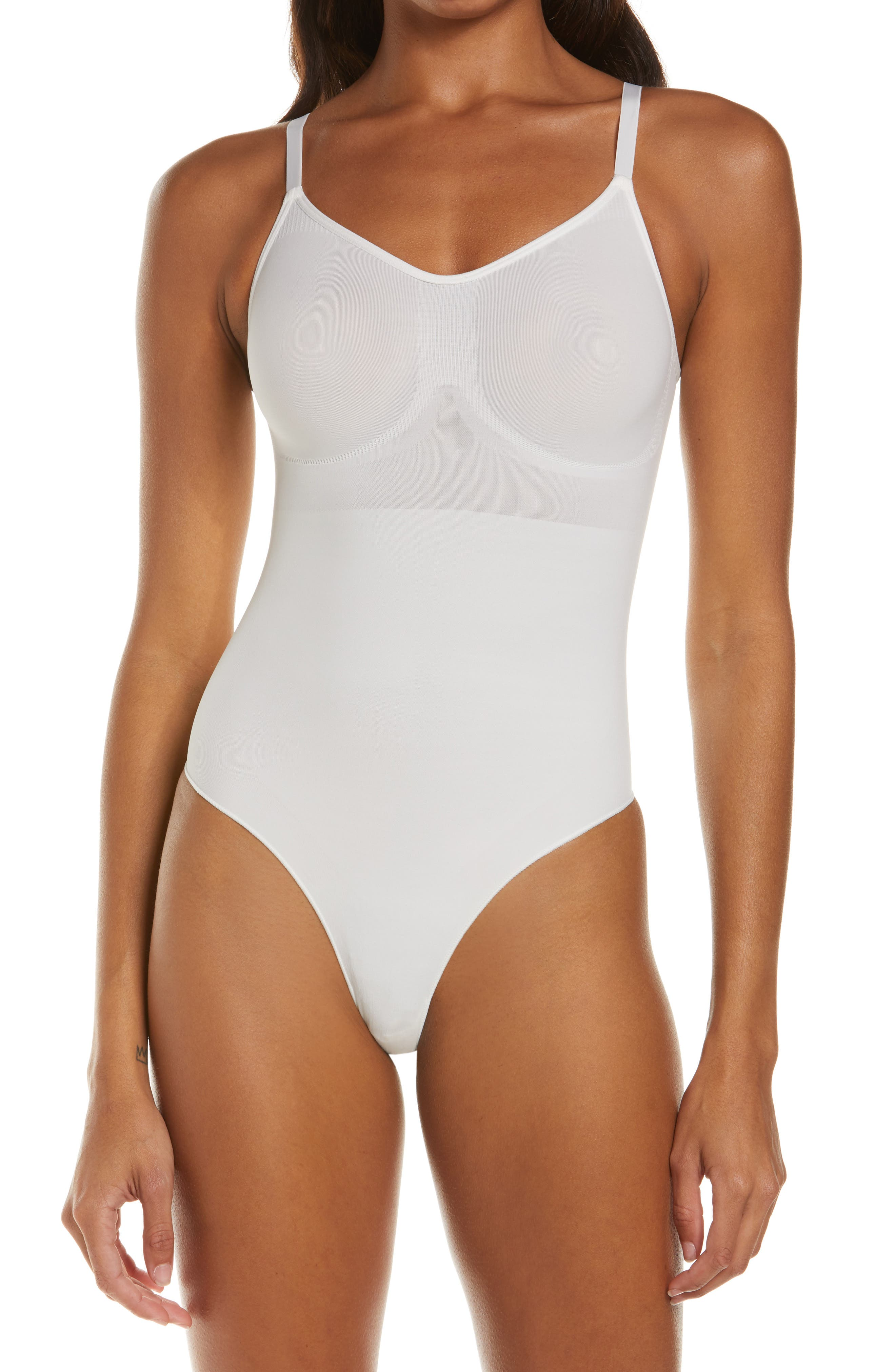 Designed to smooth your core, support your chest and cinch your waist, this high-cut thong bodysuit provides invisible sculpting under clothes. Style Name: Skims Seamless Sculpt Sculpting Thong Bodysuit. Style Number: 6139692. Available in stores.
