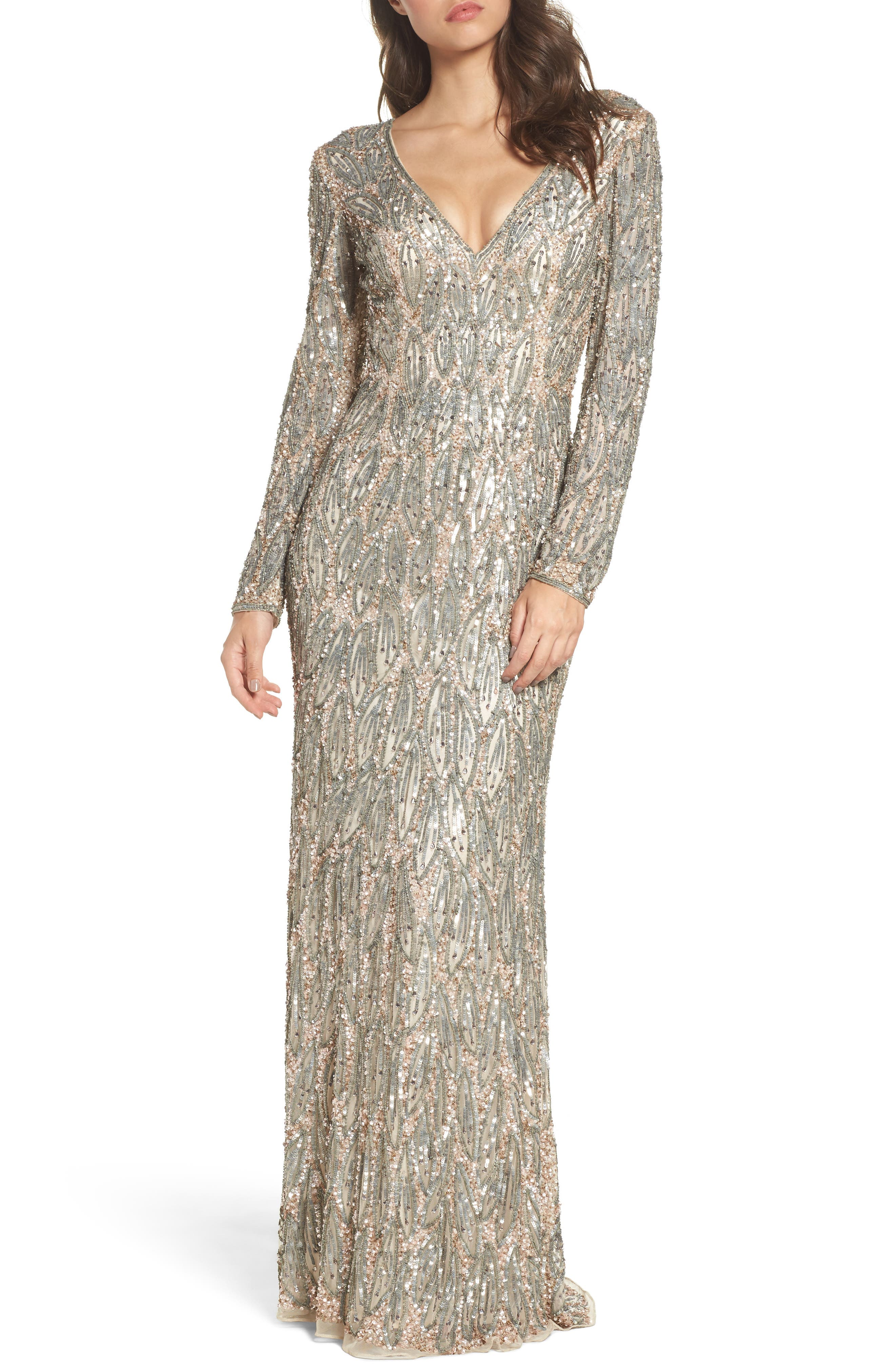 Metallic beads and sequins placed in a dreamy leaf pattern create a lithe V-neck gown with the serene, magical elegance of a willow tree. Style Name: Mac Duggal Beaded Long Sleeve Gown. Style Number: 5458638 1. Available in stores.