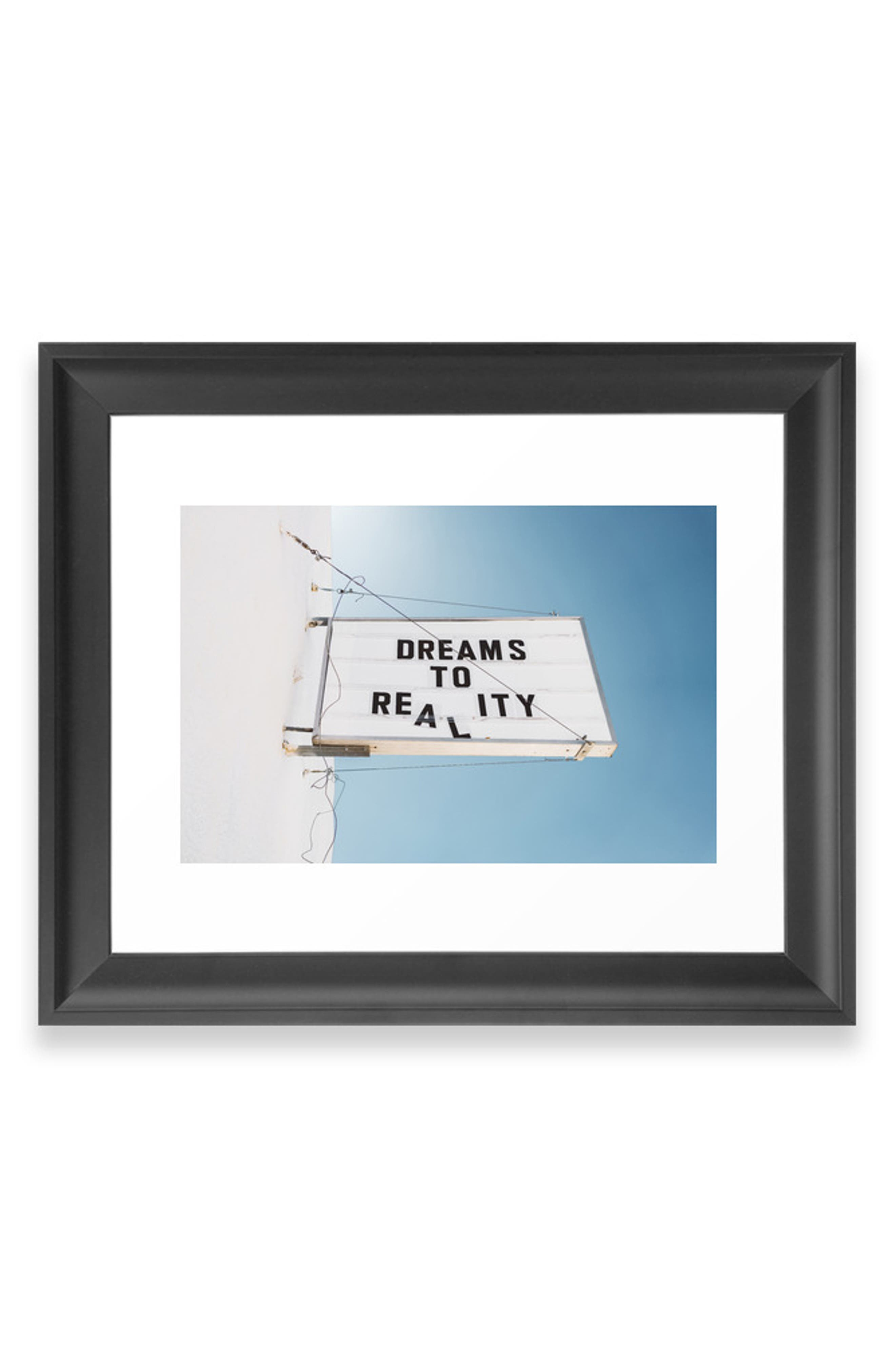A positive message captured by Bethany Young takes center stage on a satin-finish art print available on its own or in a ready-to-hang frame. Style Name: Deny Designs Dreams To Reality Art Print. Style Number: 5867639 1. Available in stores.
