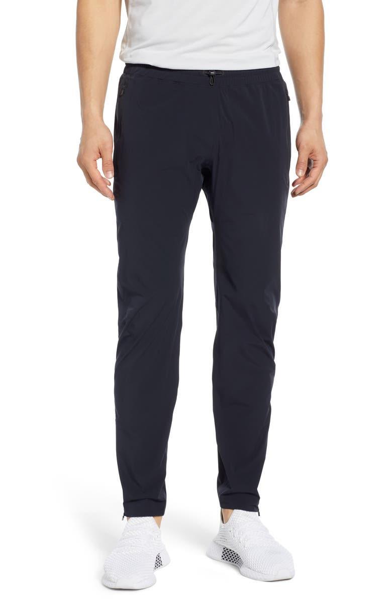 REIGNING CHAMP Team Water Repellent Track Pants, Main, color, BLACK