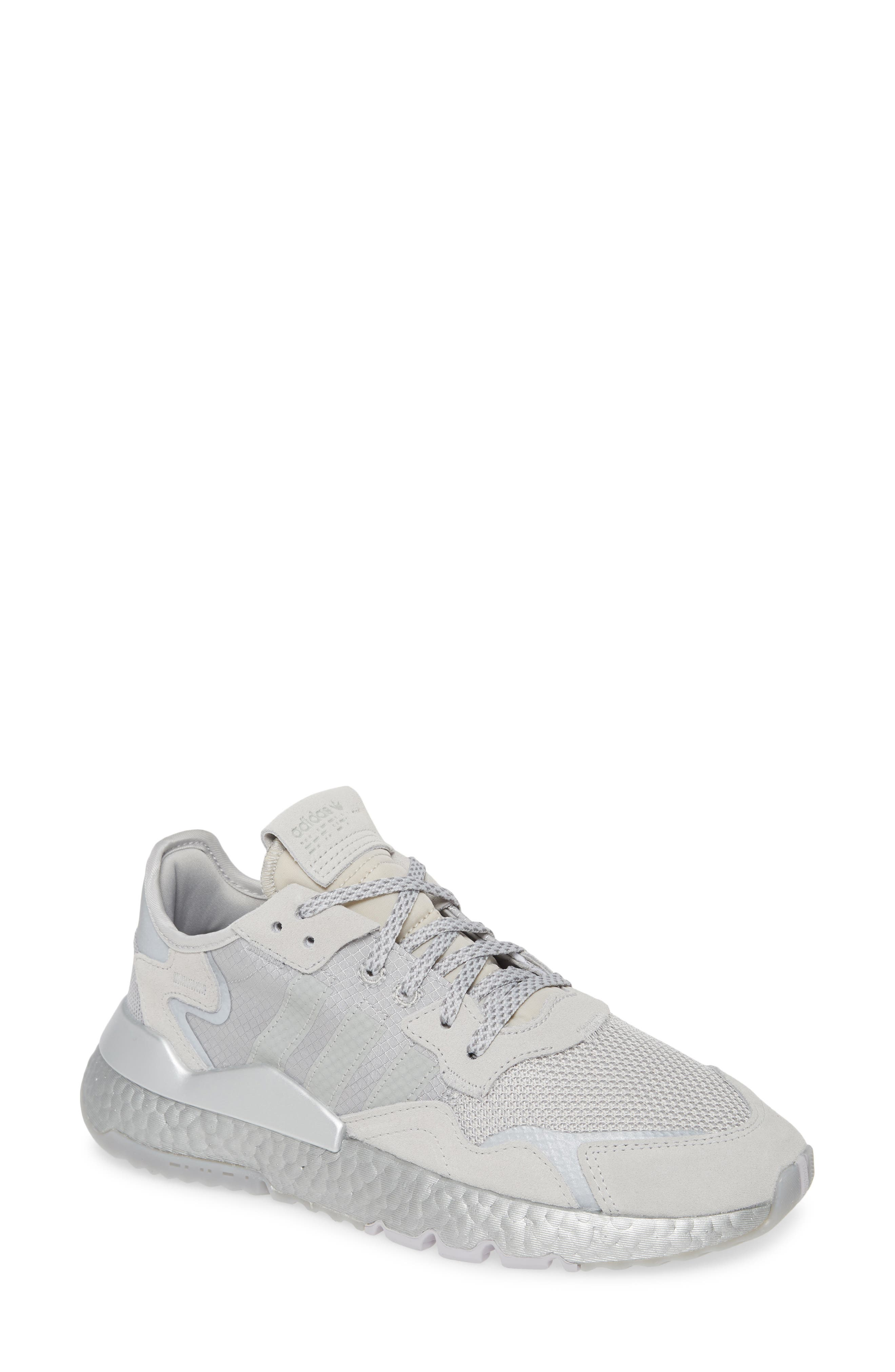Mesh, ripstop nylon and responsive Boost cushioning update a heritage running shoe that\'s reborn as a lightweight sneaker that\'s easy to crush and pack. A stabilizing heel cup and grippy insets in the tread keep you on your feet day or night. Style Name: Adidas Nite Jogger Sneaker (Women). Style Number: 5748006 6. Available in stores.
