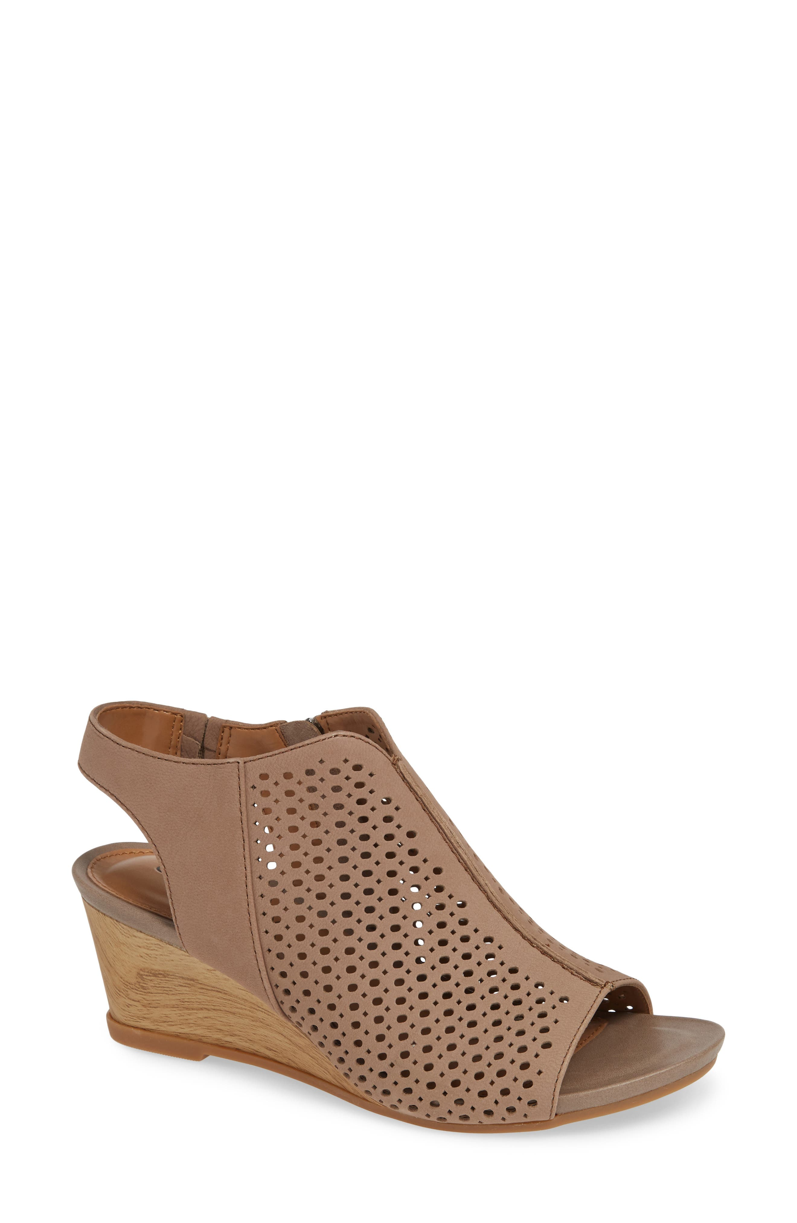 A contemporary perforated upper lets cool breezes in while you stride under the sun wearing these pillowy-soft sandals with a lightweight wood-textured wedge. Style Name: Comfortiva Skylyn Wedge Sandal (Women). Style Number: 5759380. Available in stores.