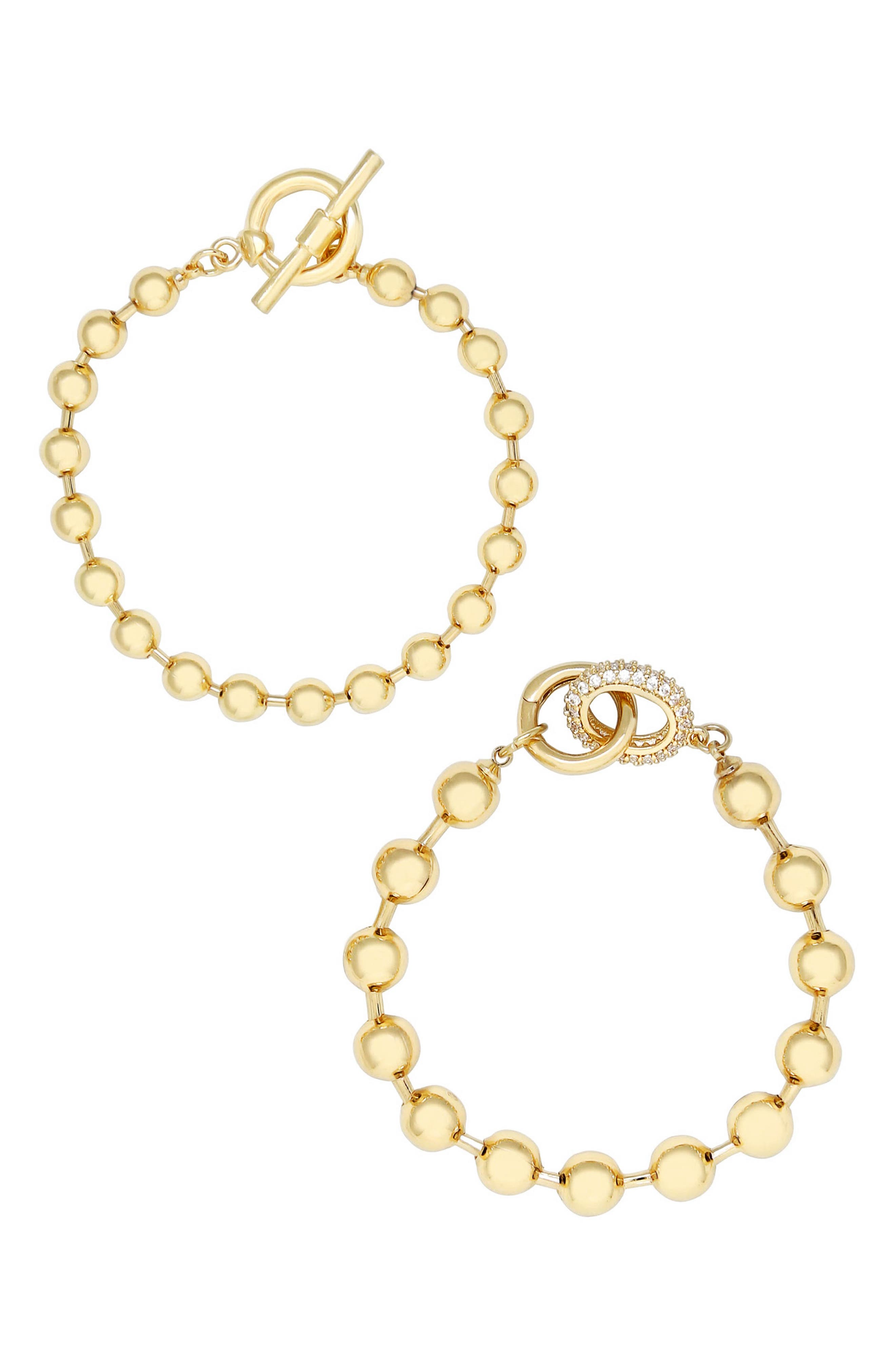 Either layered or stacked with other favorites, this set of two 18-karat gold-plated ball-chain bracelets is sure to become your new favorite. Style Name: Ettika Set Of 2 Ball Chain Bracelets. Style Number: 6176181. Available in stores.