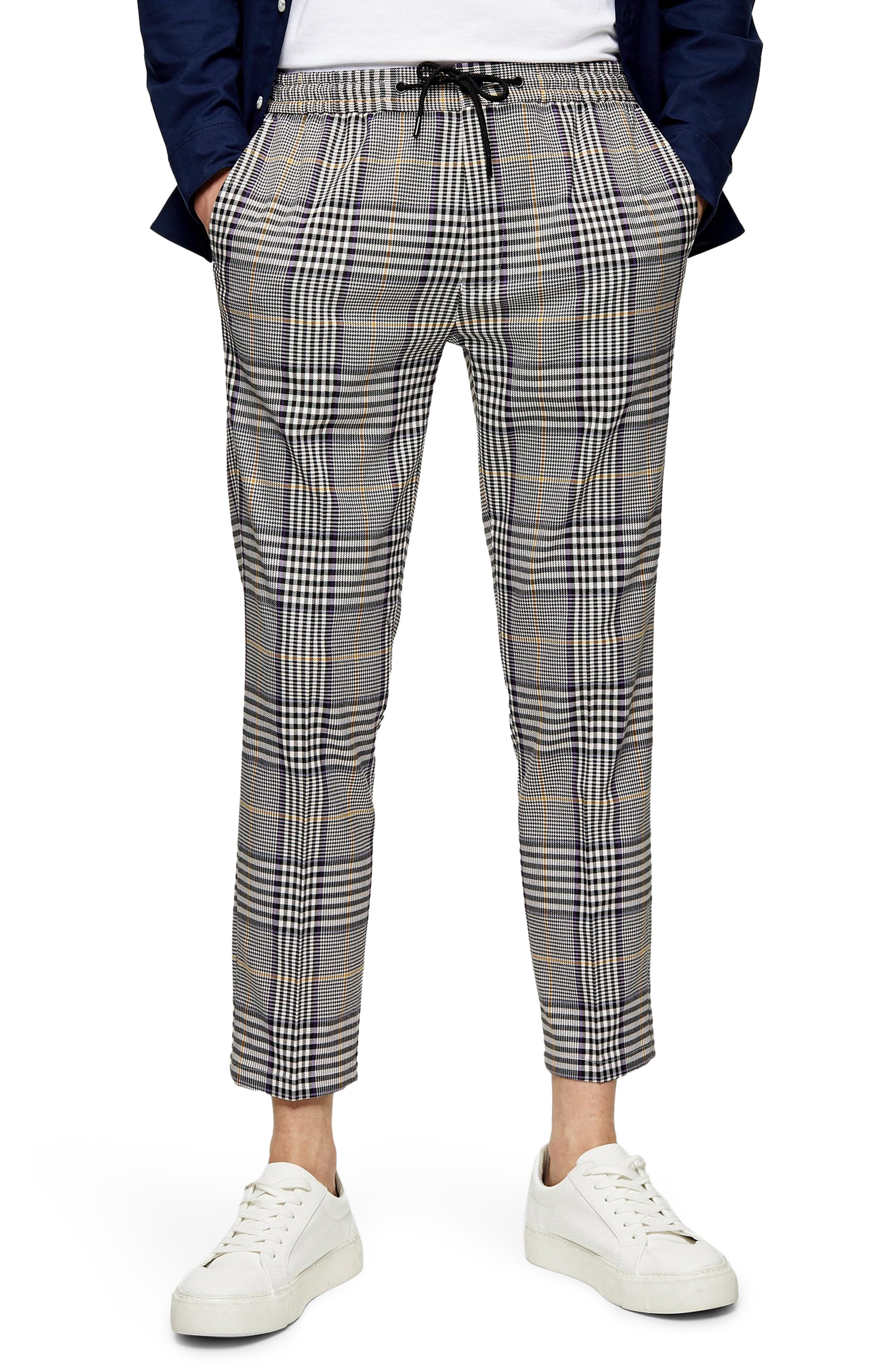 A cropped length kicks up the suave street style of drawstring trousers patterned in a \\\'90s-inspired plaid. Style Name: Topman Whyatt Plaid Crop Trousers. Style Number: 6096075. Available in stores.