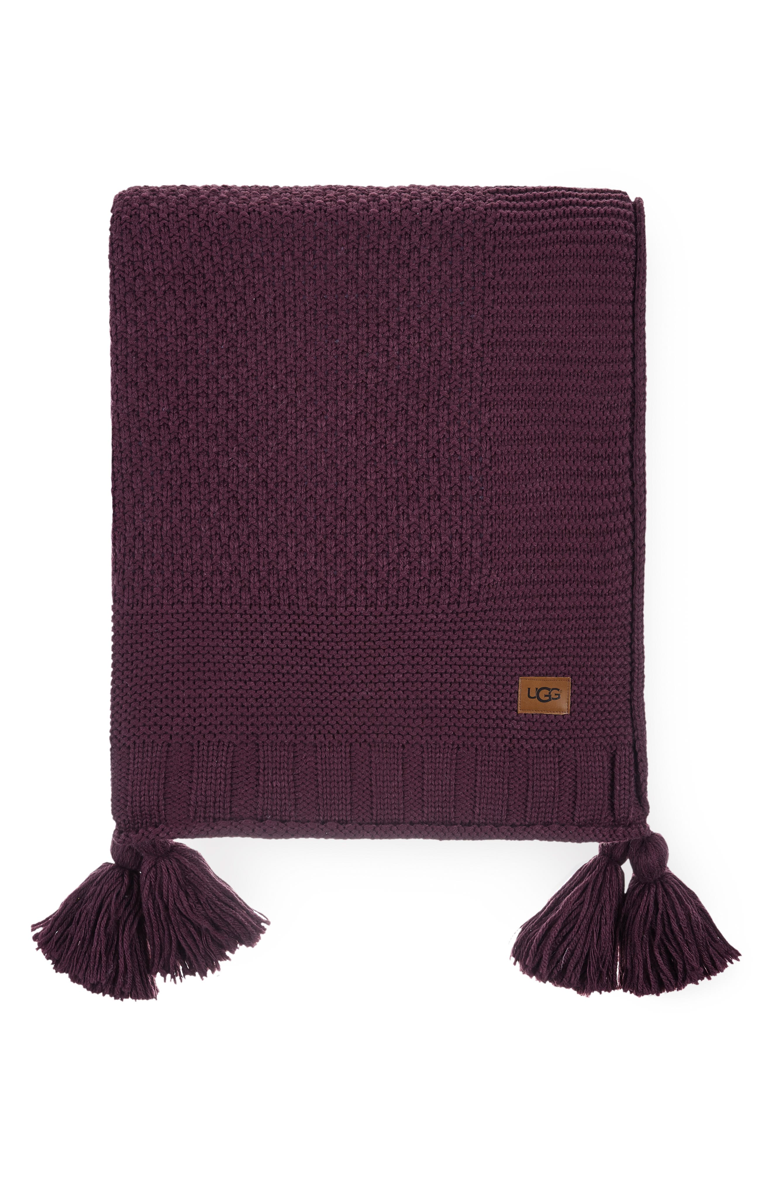 Mixed stitches lend subtle depth to a classic throw blanket knit from soft, thick yarns and trimmed in jaunty tassels. Style Name: UGG Preston Throw Blanket. Style Number: 5941643. Available in stores.