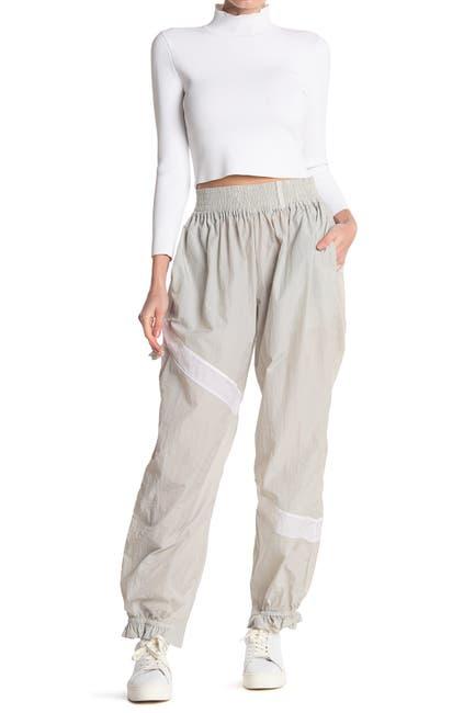 Image of GANNI Crinkled Tech Pants