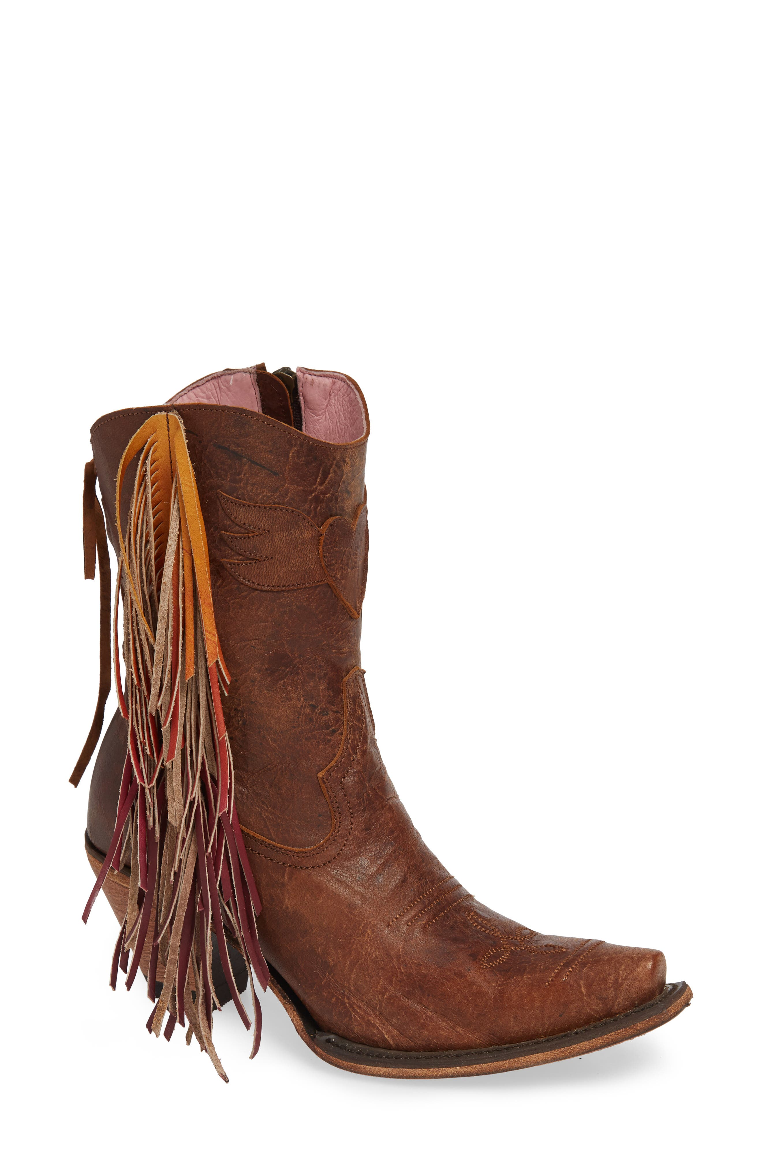 Hand-painted fringe accentuates the playful movement of every step you take in this leather bootie featuring classic, Western stitching and a winged heart. Part of a limited collaboration between LANE BOOTS and eclectic boho brand Junk Gypsy. Style Name: Lane Boots X Junk Gypsy Fringe Western Bootie (Women). Style Number: 5727896. Available in stores.