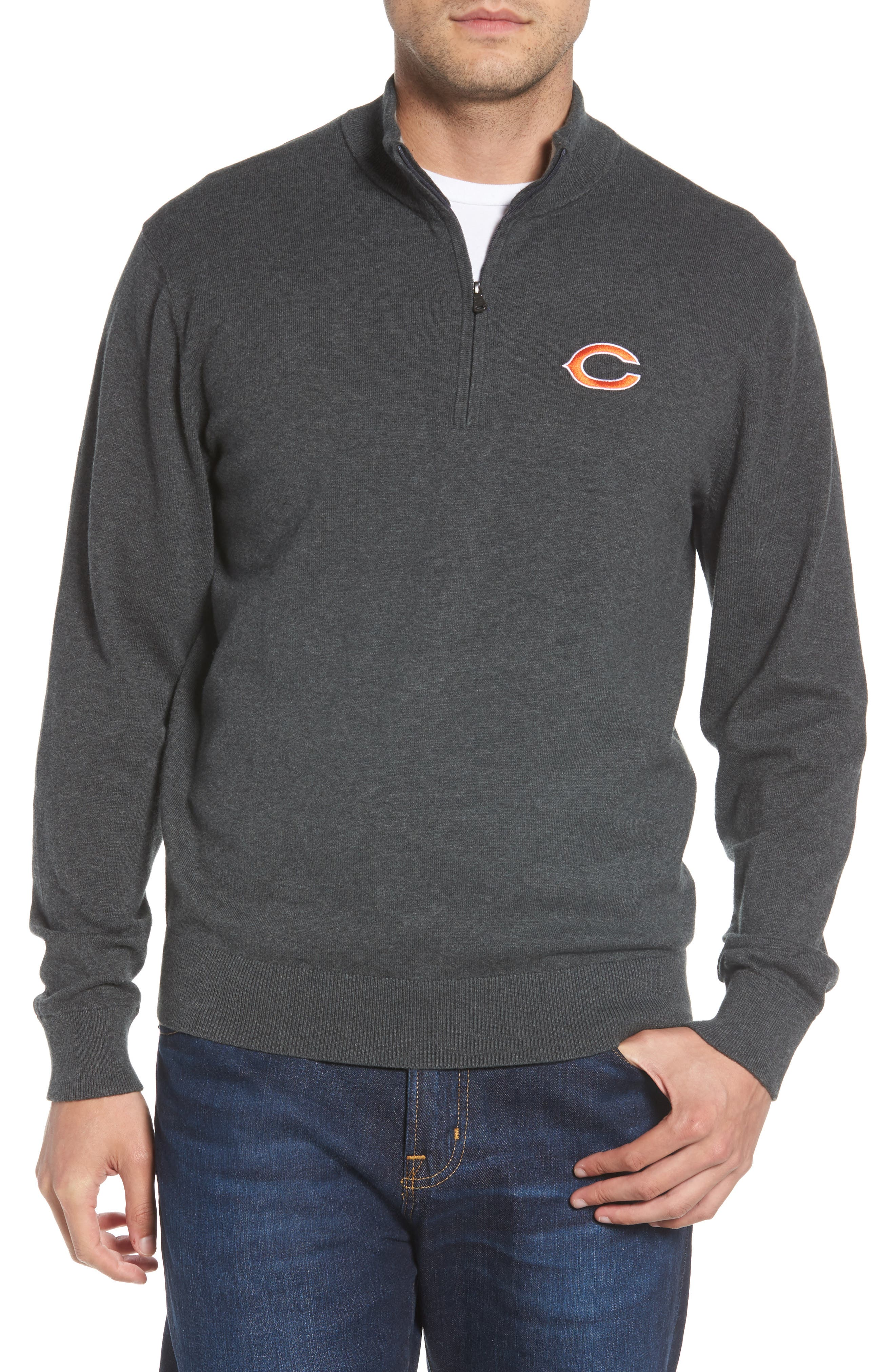 Look sharp from the office to the stadium in a mock-neck sweater that makes a handsome layering piece for brisk days. The lightweight jersey knit is reinforced at the collar and cuffs with double-layer ribbing for warmth and contrast. Style Name: Cutter & Buck Chicago Bears - Lakemont Regular Fit Quarter Zip Sweater. Style Number: 5631569. Available in stores.