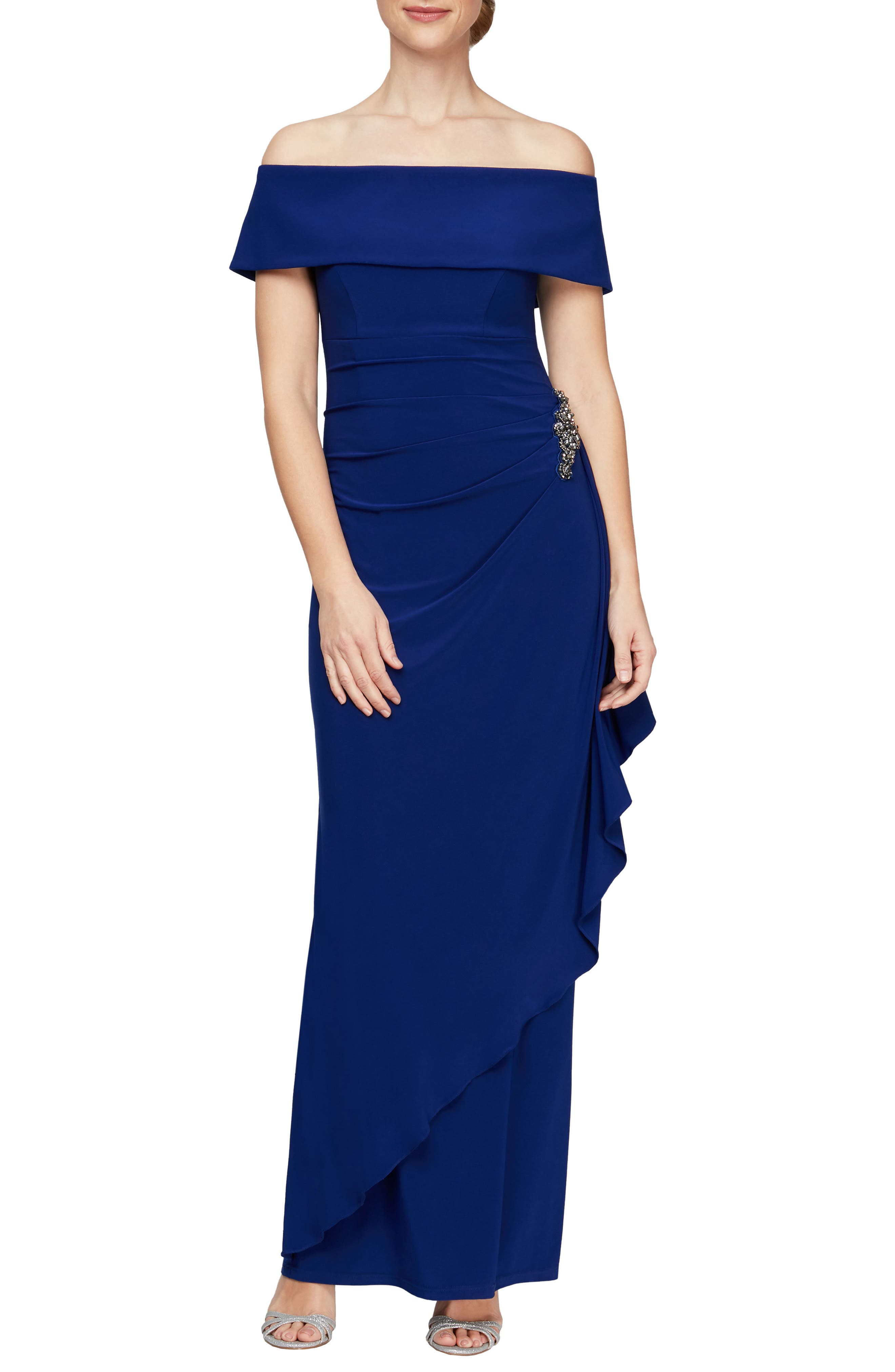 Make it a memorable evening in this elegant shoulder-baring gown styled with pretty draping and a sparkly waist embellishment. Style Name: Alex Evenings Off The Shoulder Embellished Column Gown (Plus Size). Style Number: 6087216. Available in stores.