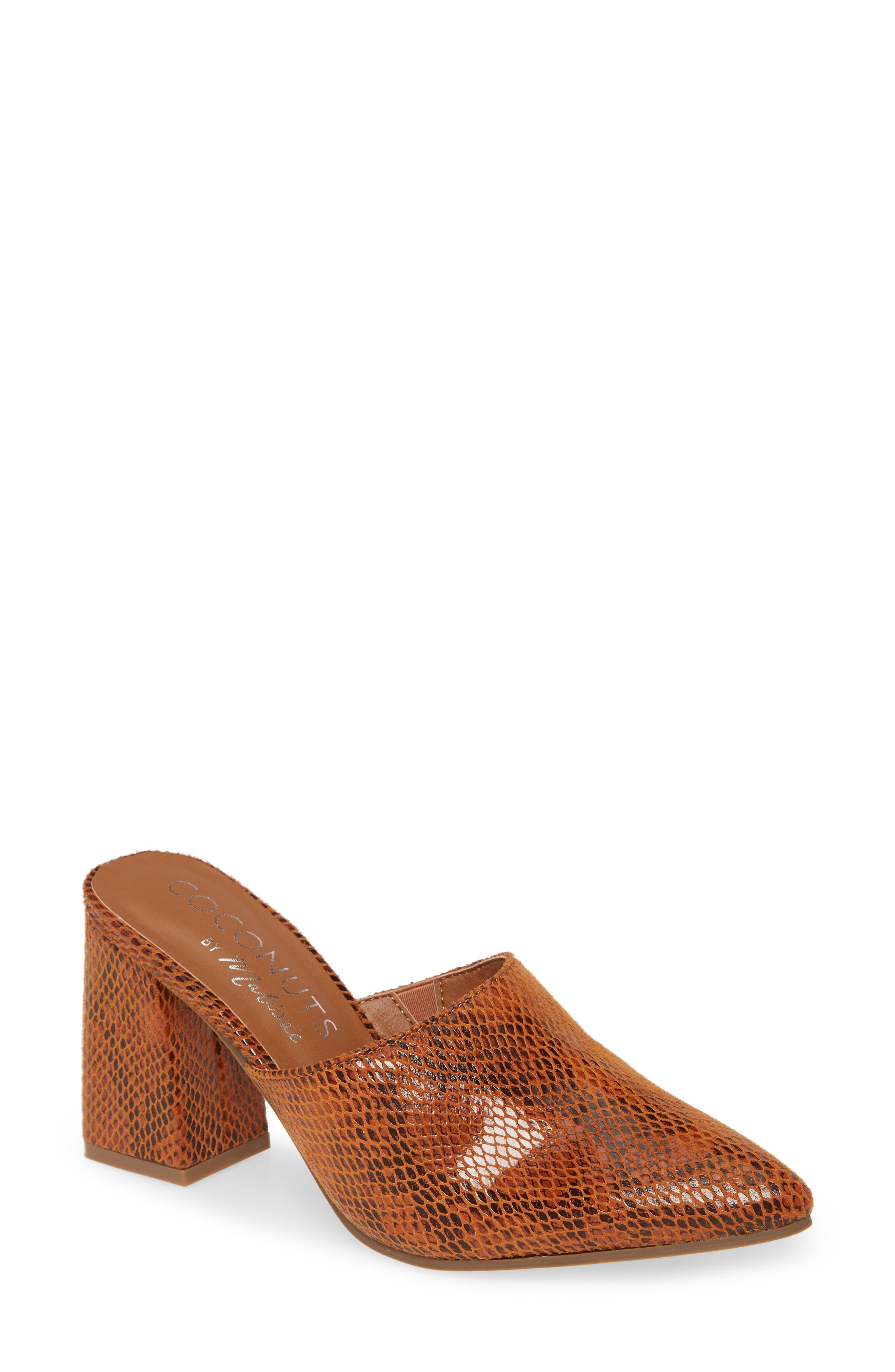 A versatile mule gets a trend-forward update with snake embossing from the pointy-toe to the wrapped, flared heel. Style Name: Coconuts By Matisse High Noon Snake Embossed Mule (Women). Style Number: 5893538. Available in stores.