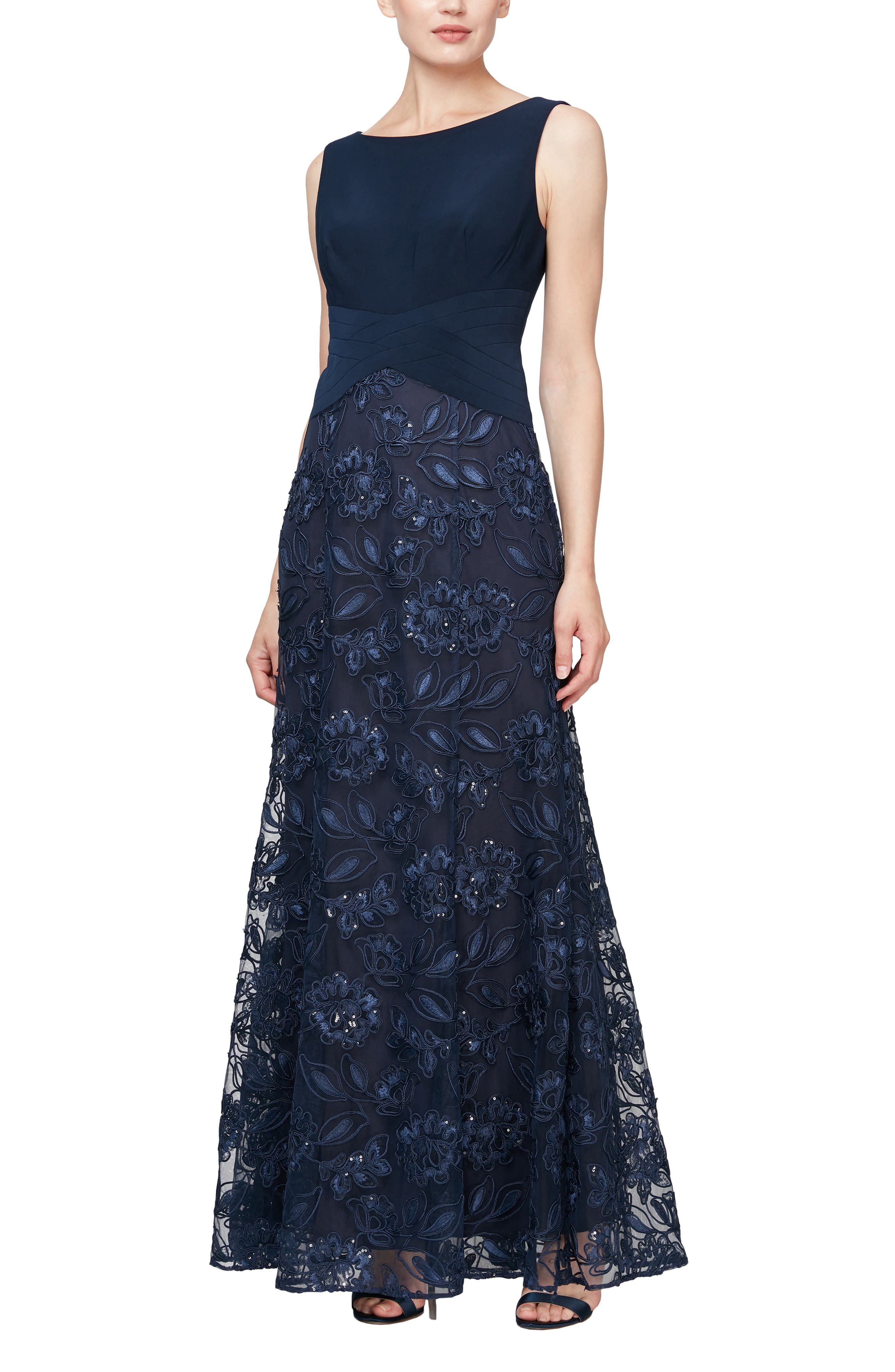 Light up the night in this glamorous sleeveless gown styled with a flattering textured waistline and a twinkling beaded skirt. Style Name: Alex Evenings Sleeveless Beaded Gown. Style Number: 6067776. Available in stores.