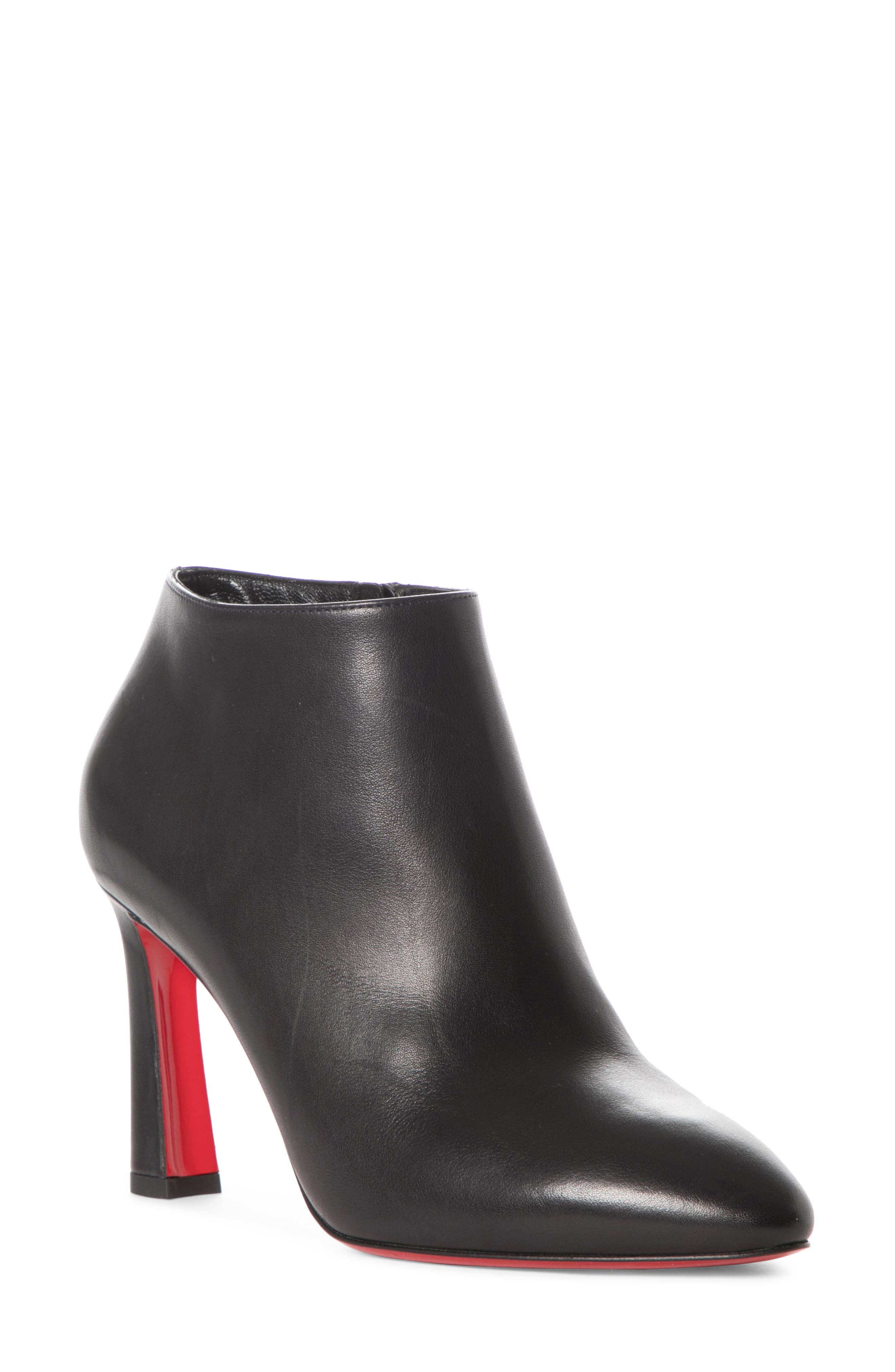Sleek and sophisticated, this smooth leather bootie is set on a modern flared heel and finished with logo hardware and that iconic Louboutin-red sole. Style Name: Christian Louboutin Eleonor Bootie (Women). Style Number: 6046881. Available in stores.
