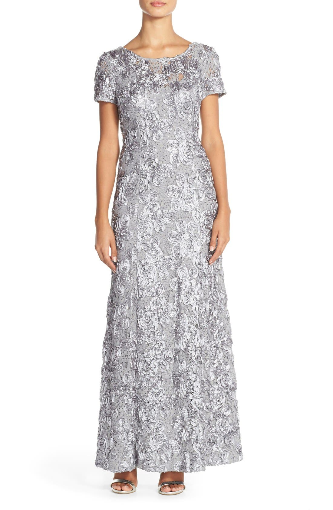 Scattered sequins sparkle among the soutache rosettes and stunning lace of this graceful gown that\\\'s ready for weddings and other special occasions. Style Name: Alex Evenings Embellished Lace A-Line Gown. Style Number: 1005168. Available in stores.