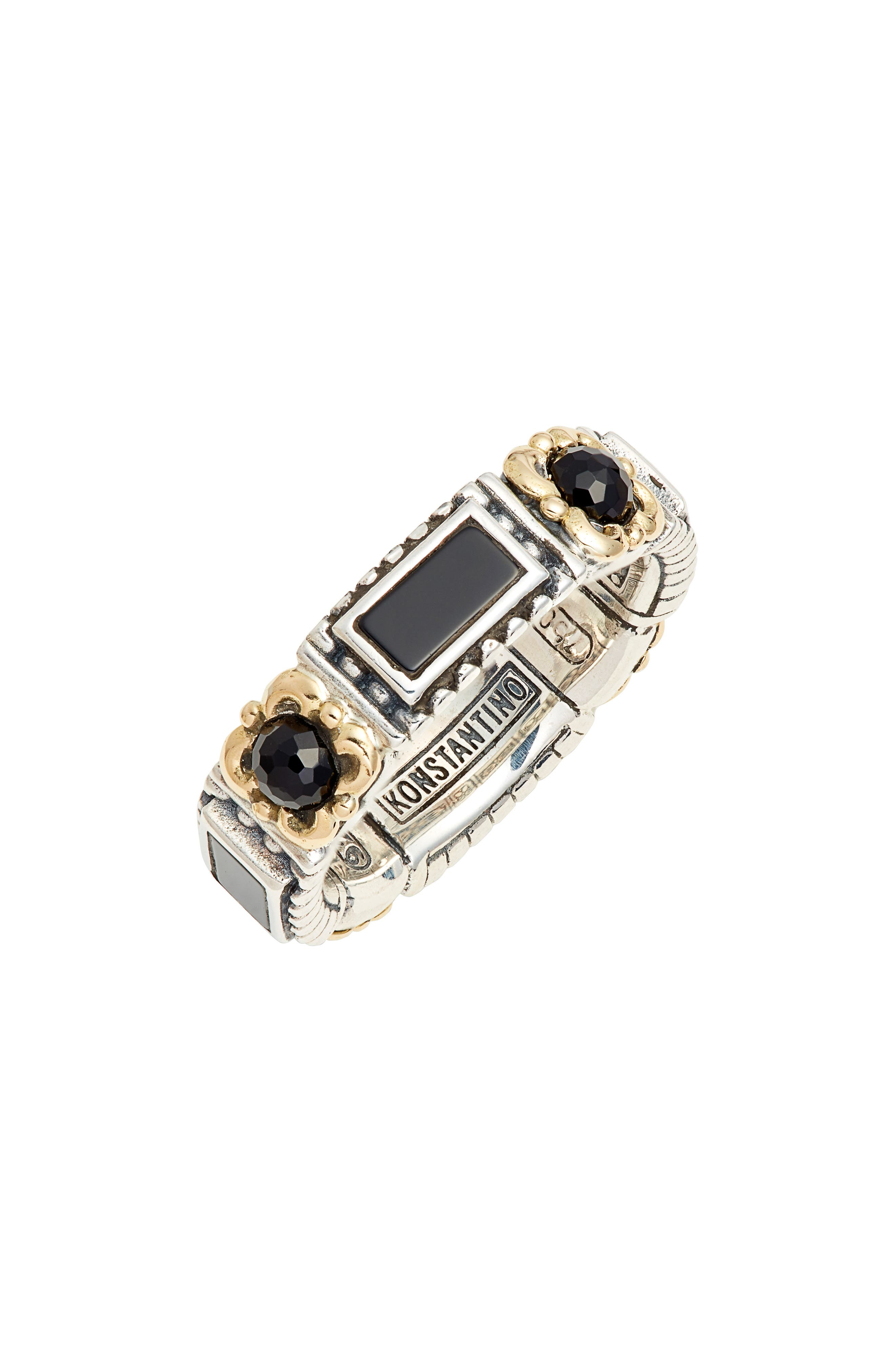 A band ring inspired by the history of ancient Greece features an ornate design handcrafted from 18-karat gold filigree, onyx and sterling silver. Style Name: Konstantino Calypso Band Ring. Style Number: 5850520. Available in stores.