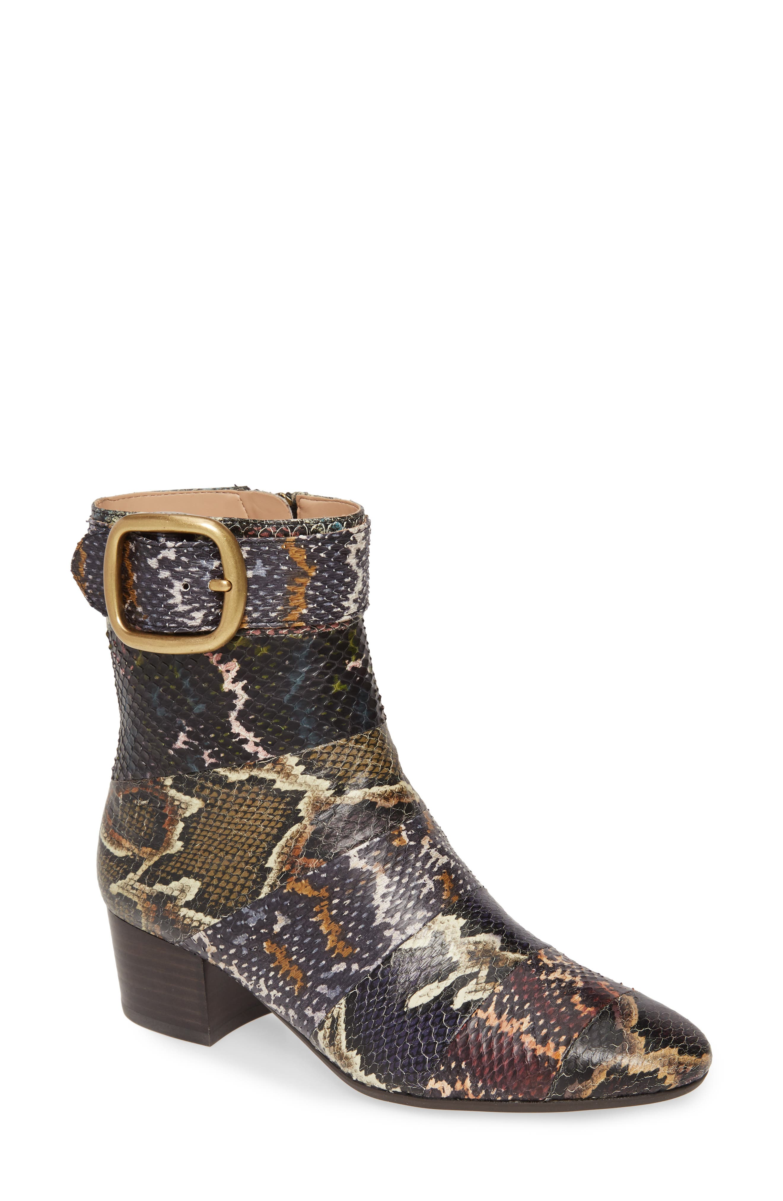 Genuine snakeskin distinguishes a clean-lined, block-heel bootie accented with a gleaming buckle and hardware. Style Name: Coach Cassandra Bootie (Women). Style Number: 5865673. Available in stores.