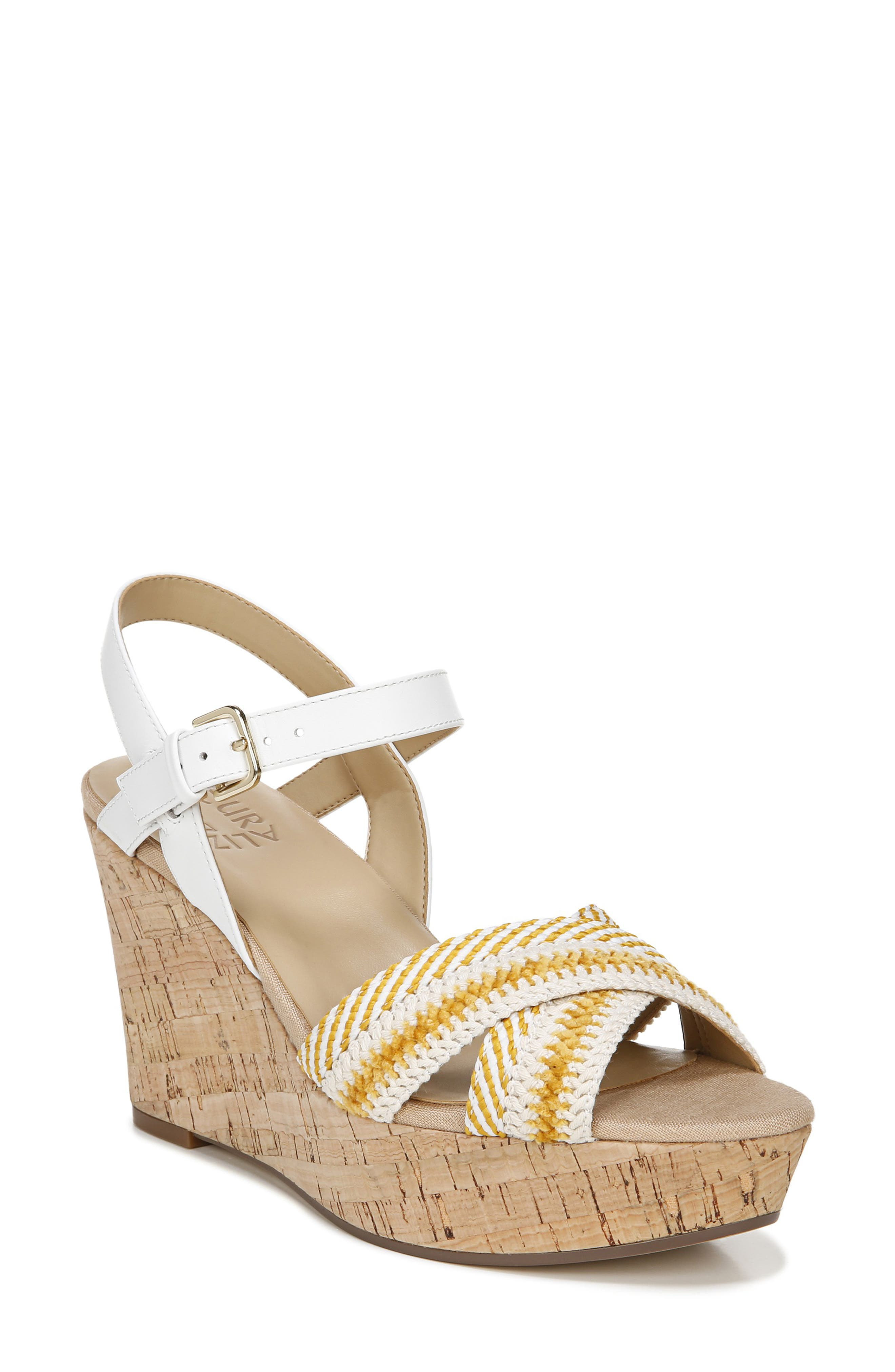 A retro crisscross quarter-strap sandal is beautifully lifted on a textured platform that gets stability and cushioning from Comfort Plus technology. Style Name: Naturalizer Zia Platform Wedge Sandal (Women). Style Number: 6015150. Available in stores.