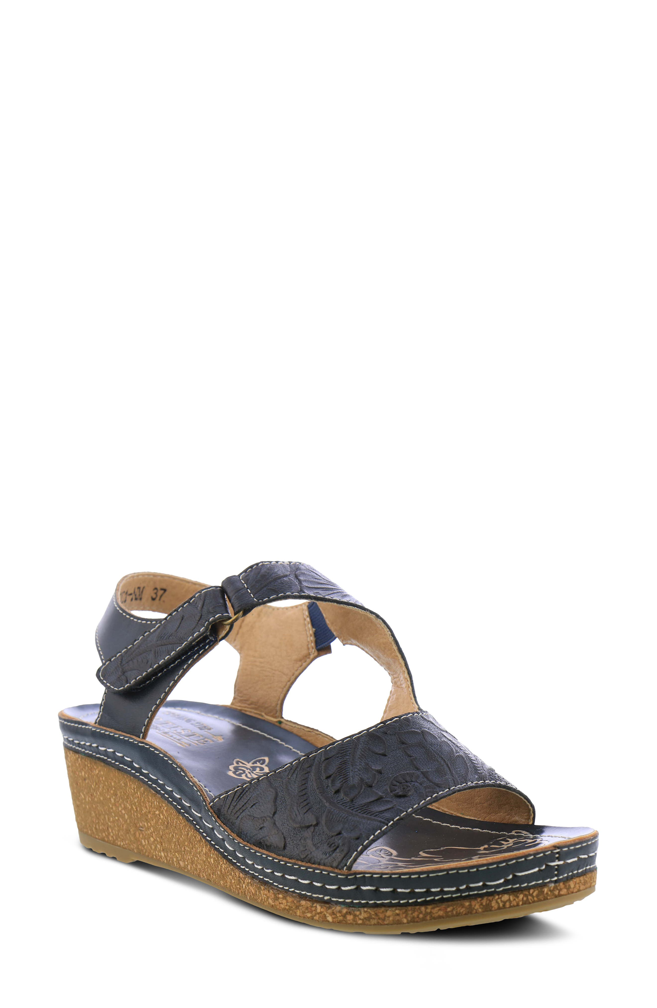 Hand-tooled floral embossing brings beautiful pattern and texture to the leather straps of a breezy sandal lifted by a comfortable cork-infused wedge. Style Name:L\\\'Artiste Zeta Wedge Sandal (Women). Style Number: 6000067. Available in stores.