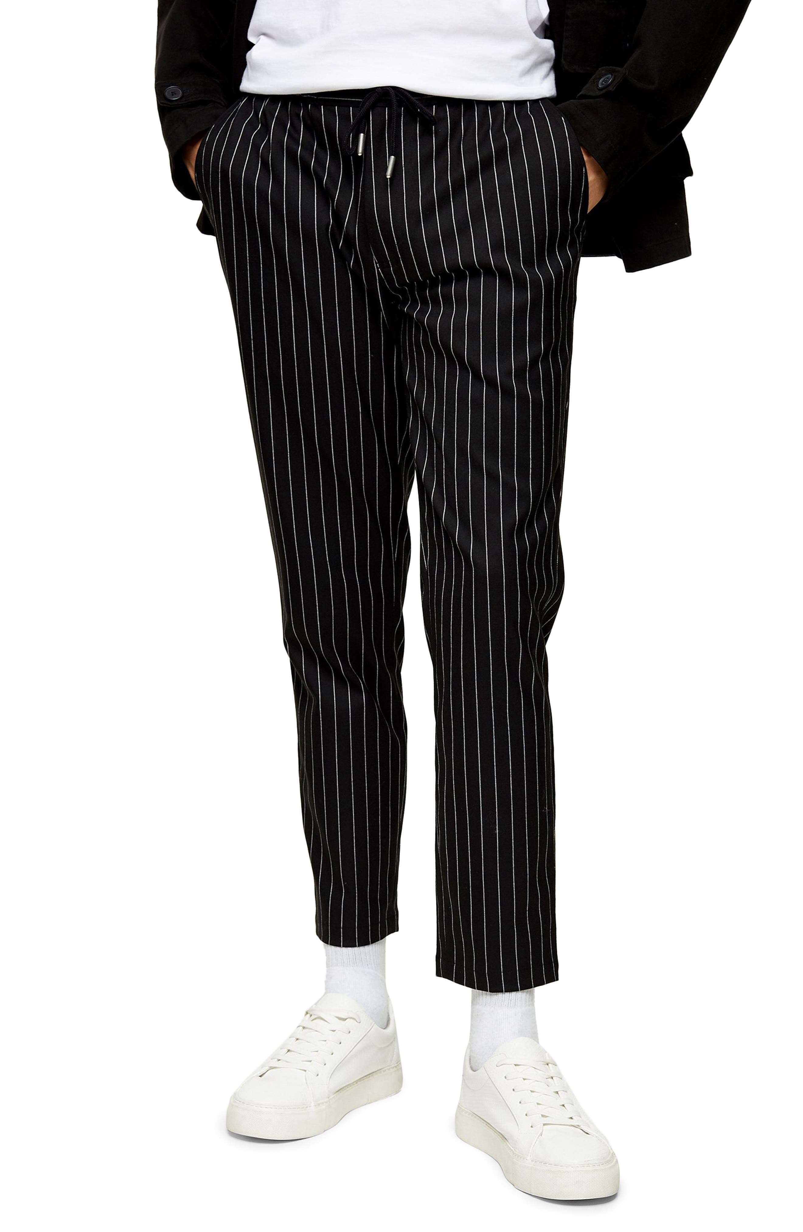 Classic pinstripes cover these modern, slim-fitting cropped pants that work from 9-to-5 and beyond. Style Name: Topman Whyatt Stripe Trousers. Style Number: 6053340. Available in stores.