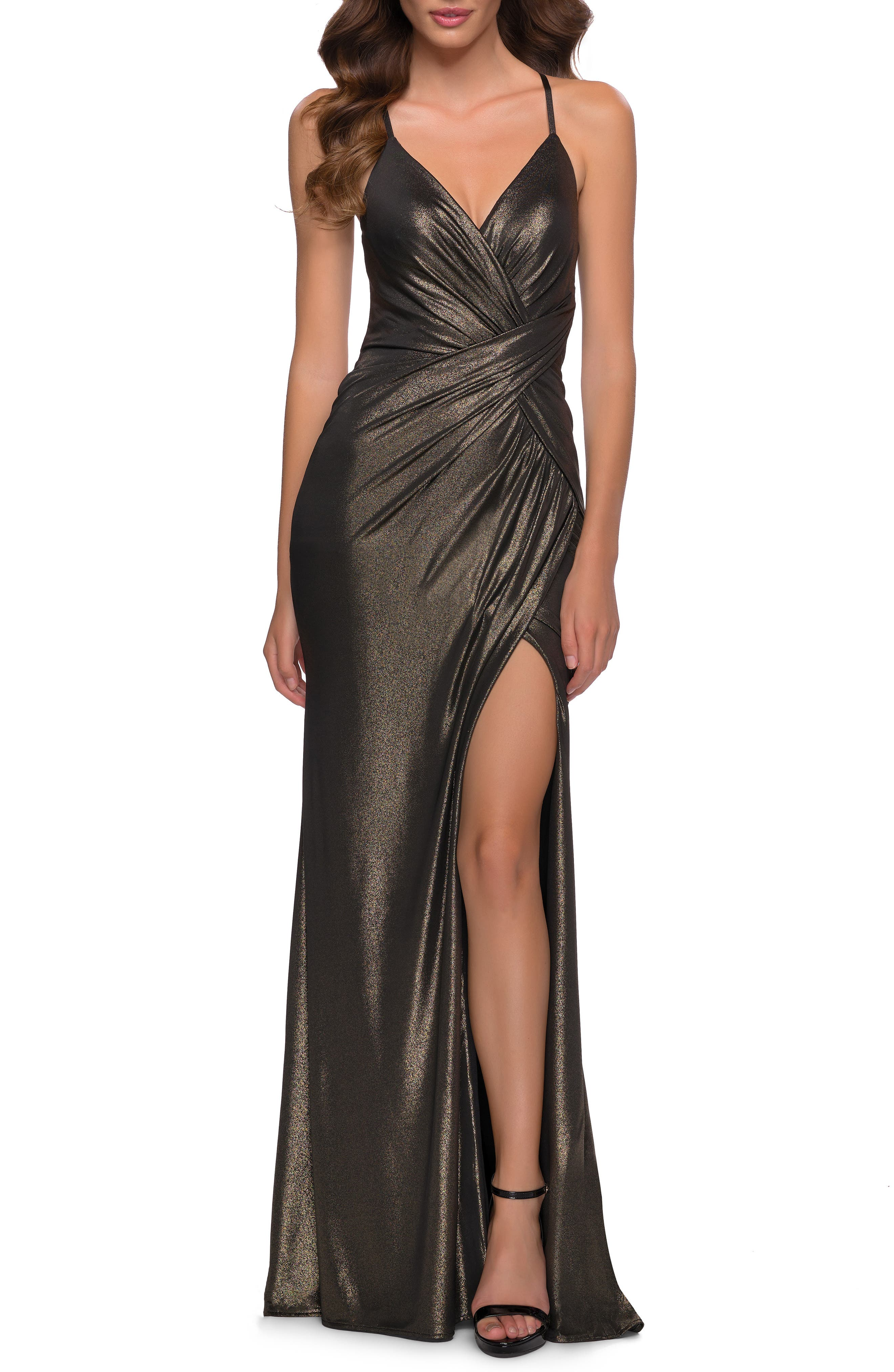 Flaunt a sultry silhouette in this shimmering jersey gown styled with a flattering drape, strappy cutout back and soaring stem-showing hem. Style Name: La Femme Spaghetti Strap Metallic Jersey Gown. Style Number: 6155862. Available in stores.