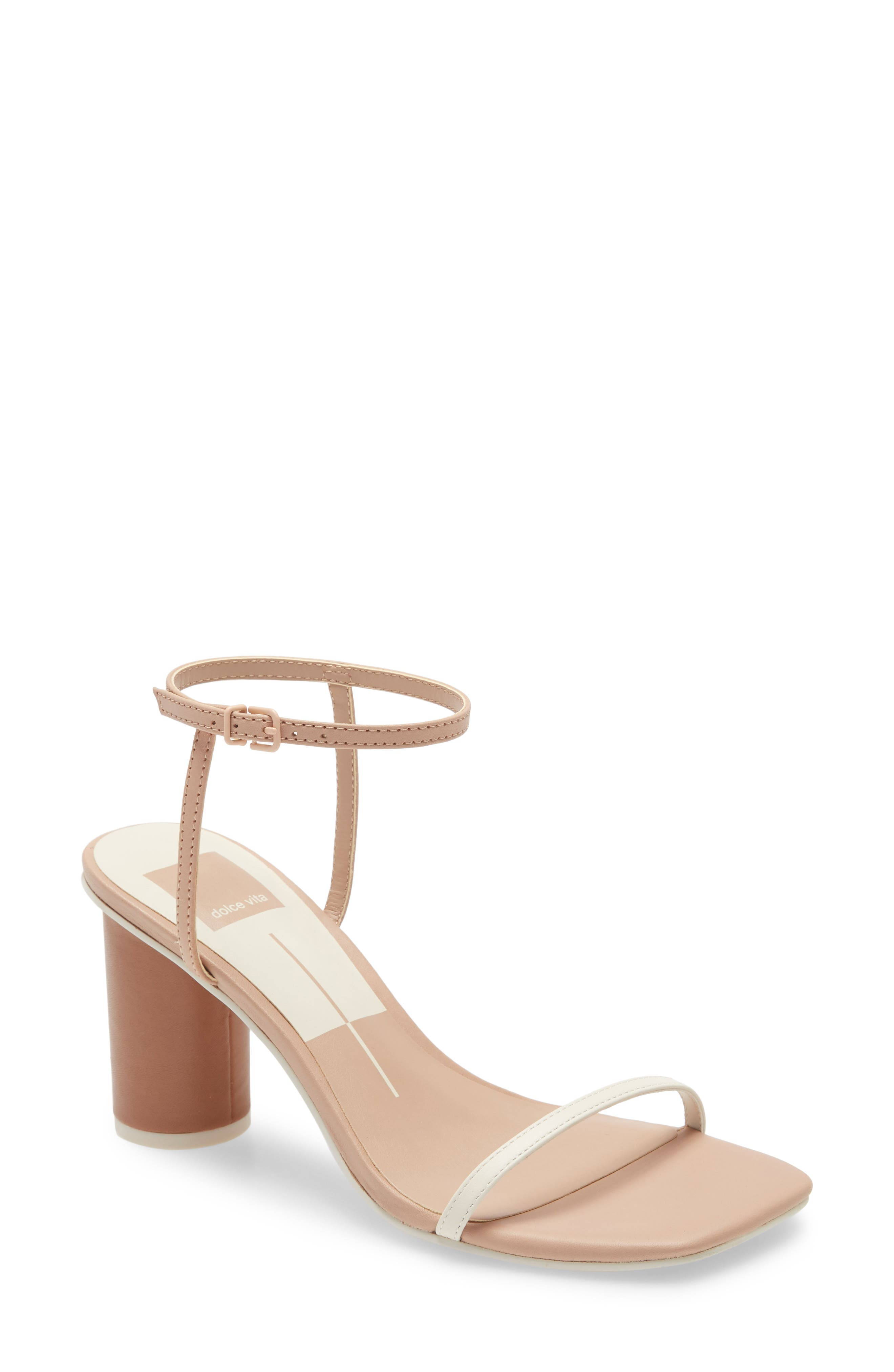 A blunted toe and wrapped column heel distinctively ground a sandal topped with straps that float across the top and around the ankle. Style Name: Dolce Vita Naomey Strappy Statement Heel Sandal (Women). Style Number: 6004184. Available in stores.