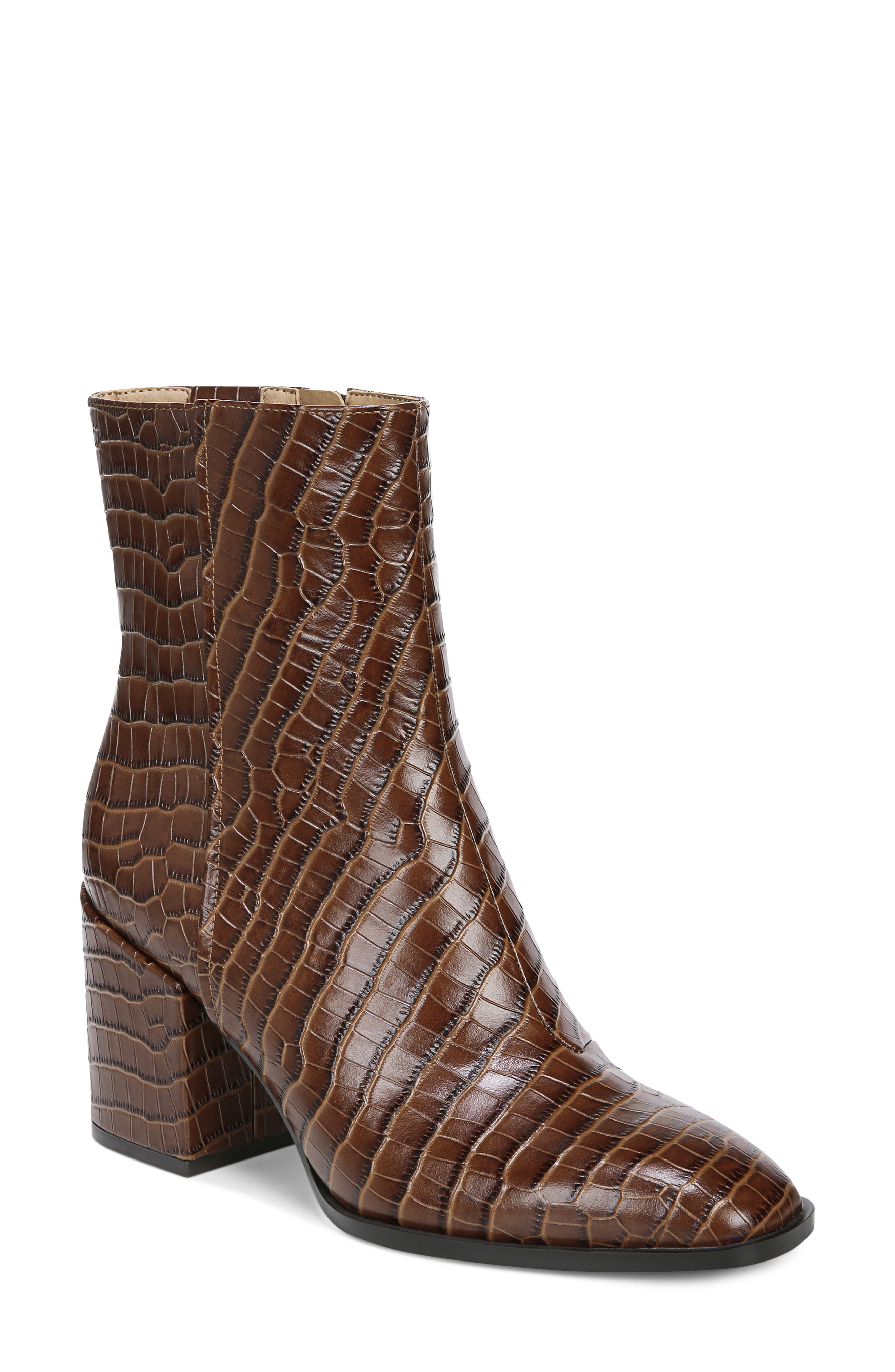 Take on the town in a vintage-inspired, croc-embossed boot elevated by a walkable block heel. An orthotically cushioned footbed with signature Orthaheel technology helps support the natural alignment of the foot with every step you take. Style Name: Vionic Harper Block Heel Bootie (Women). Style Number: 6104268. Available in stores.
