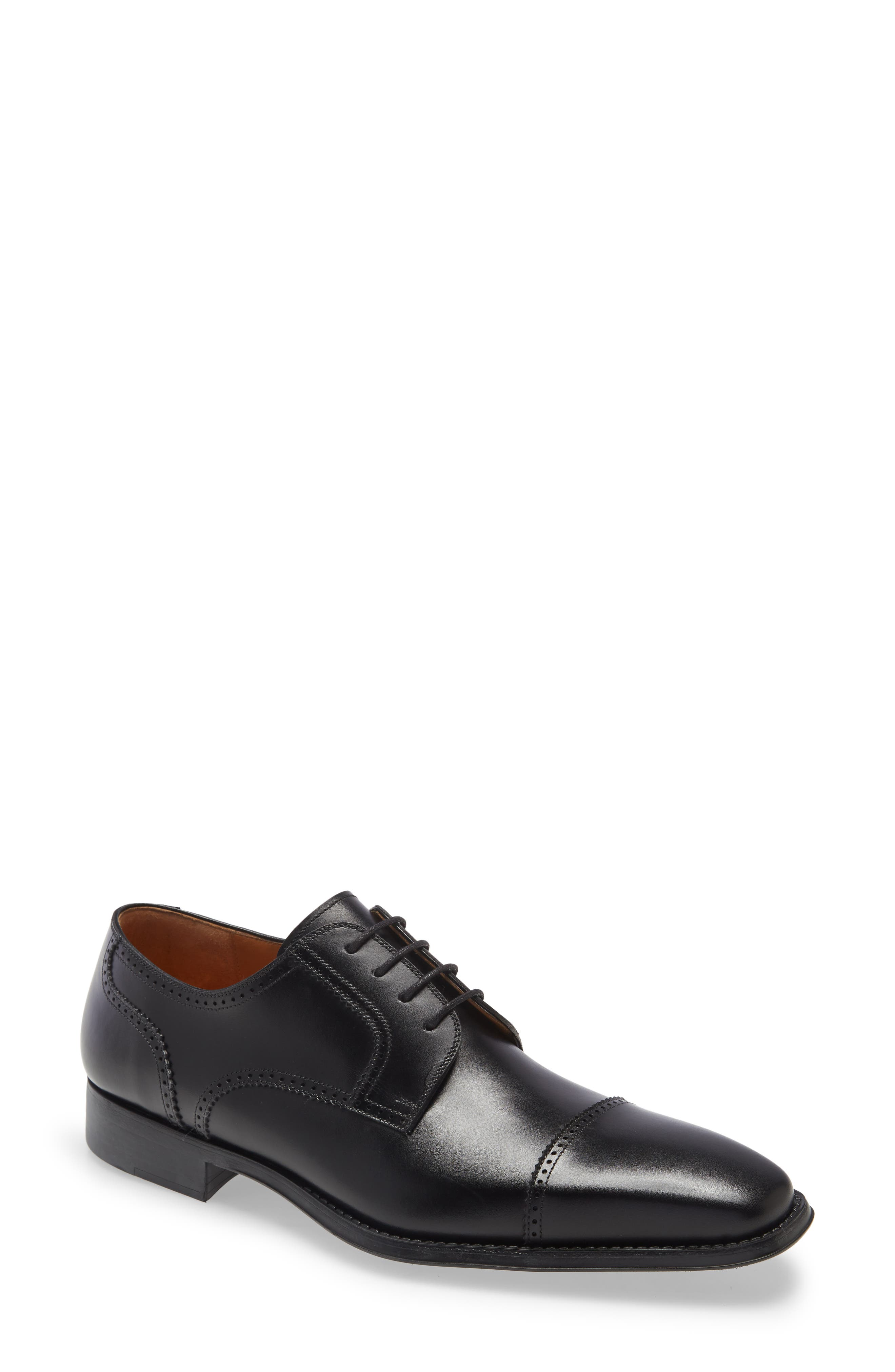 Handsome broguing traces the contours of a polished leather derby that pairs a breathable leather interior with a squared cap toe and angular Euro footprint. Style Name: Magnanni Carl Cap Toe Derby (Men). Style Number: 5994249. Available in stores.