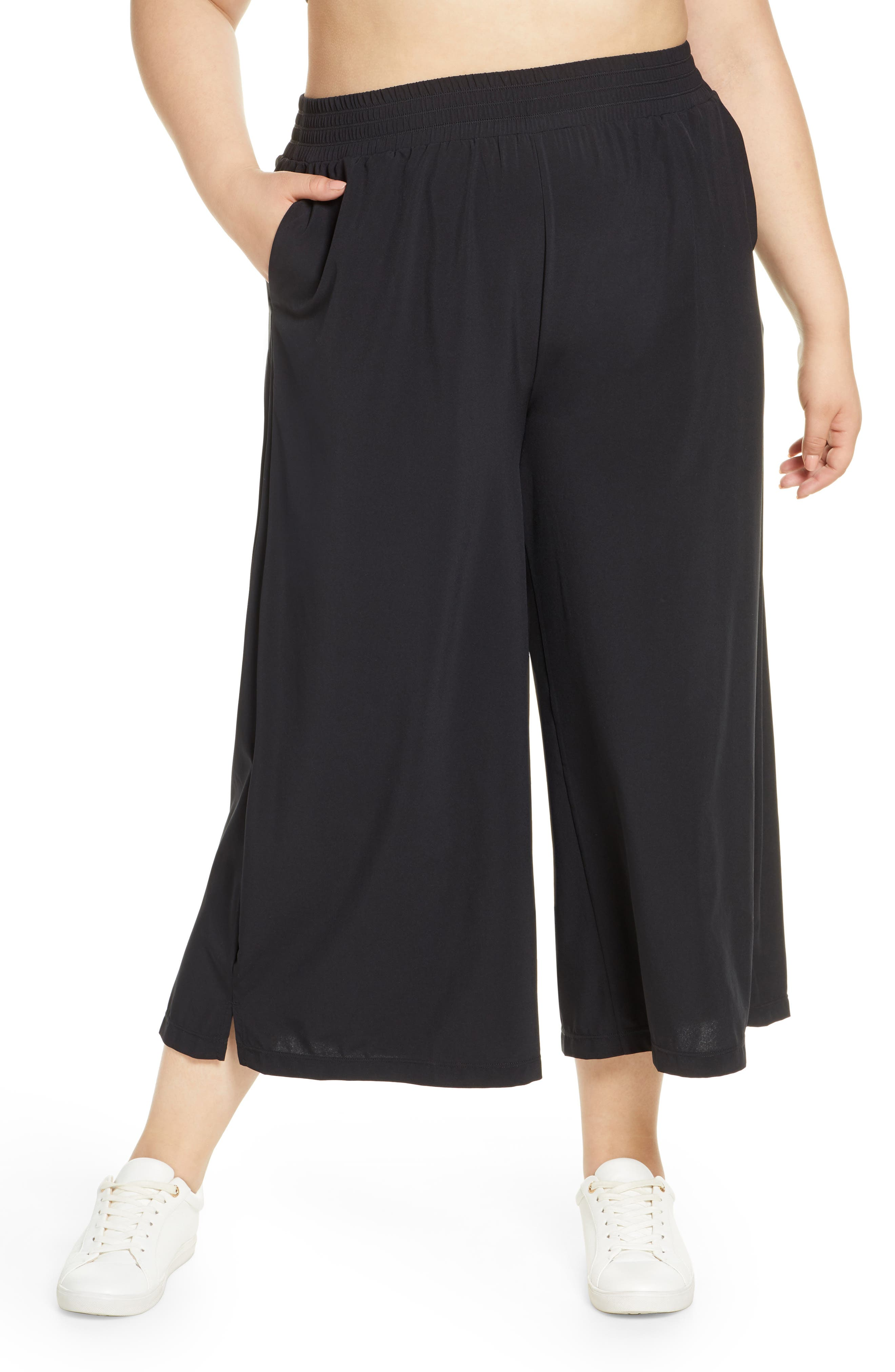 Swingy cropped pants with a comfortable high rise and convenient front pockets are perfect for working out or lounging at home. Style Name: Zella High Waist Crop Wide Leg Woven Pants (Plus Size). Style Number: 5950697. Available in stores.