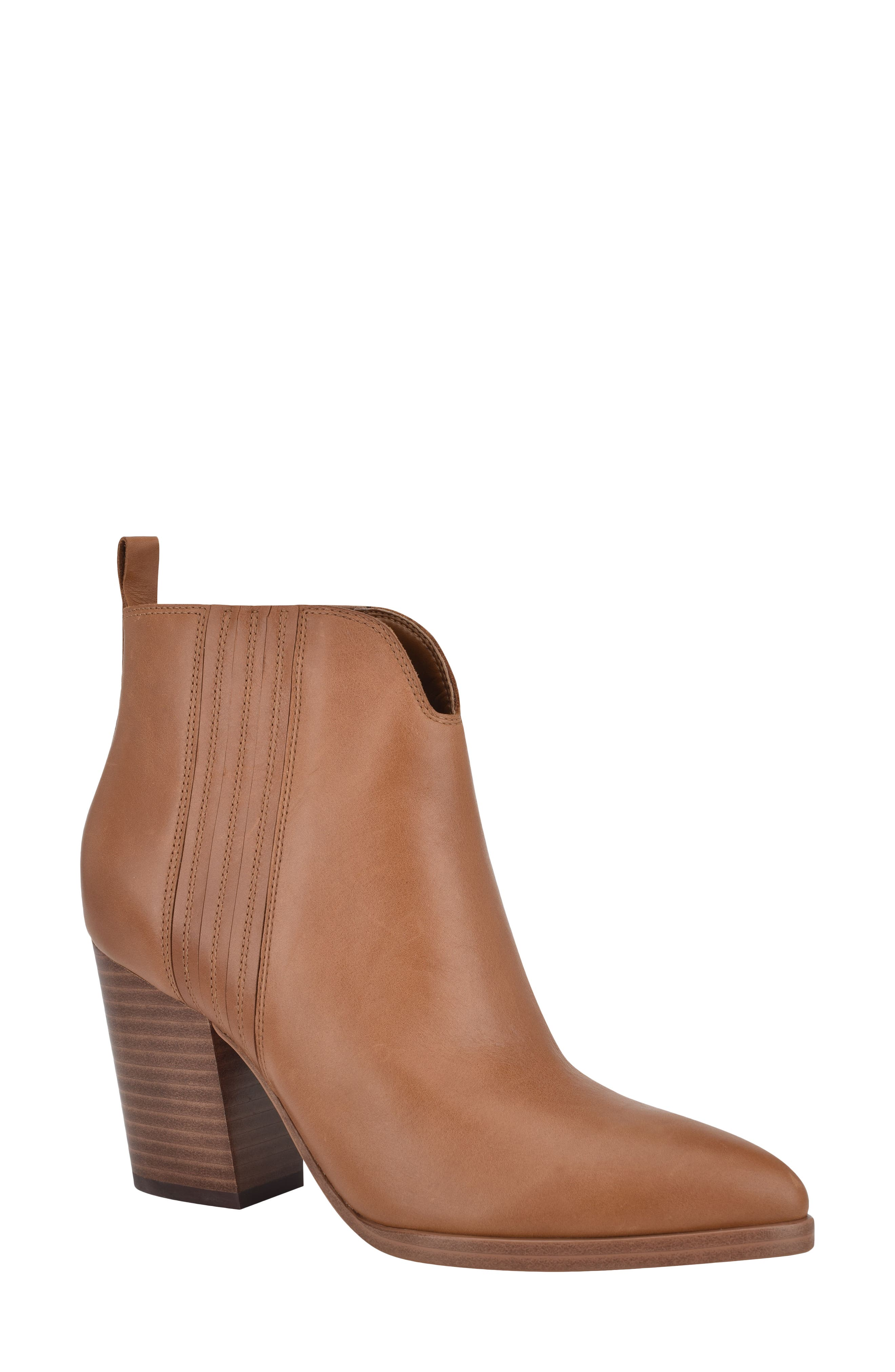 A gently pointed toe and tall stacked heel balance a versatile bootie with hidden elastic-gore insets at the sides. Style Name: Marc Fisher Ltd Annabel Bootie (Women). Style Number: 6061735. Available in stores.