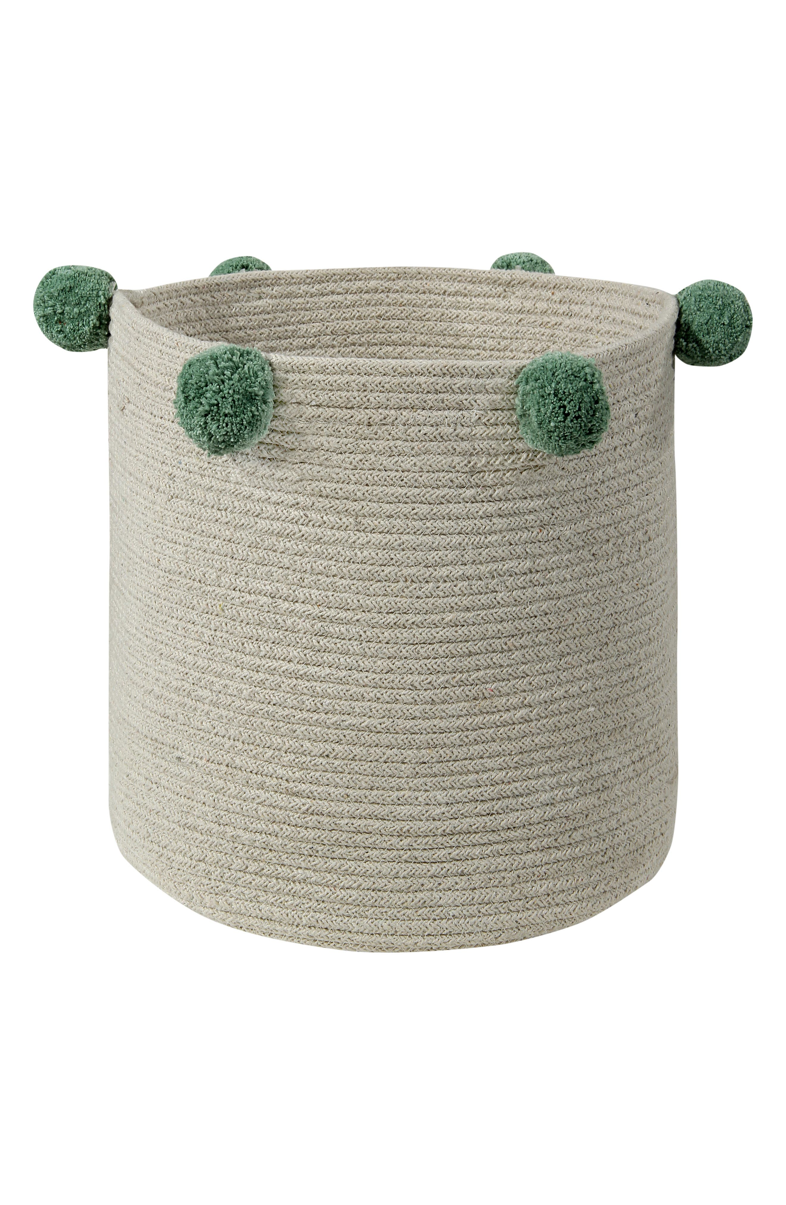 Pompom trim adds a fun flourish to a handmade basket that provides ideal toy storage while making any nursery extra charming. Style Name: Lorena Canals Bubbly Basket. Style Number: 5869423. Available in stores.