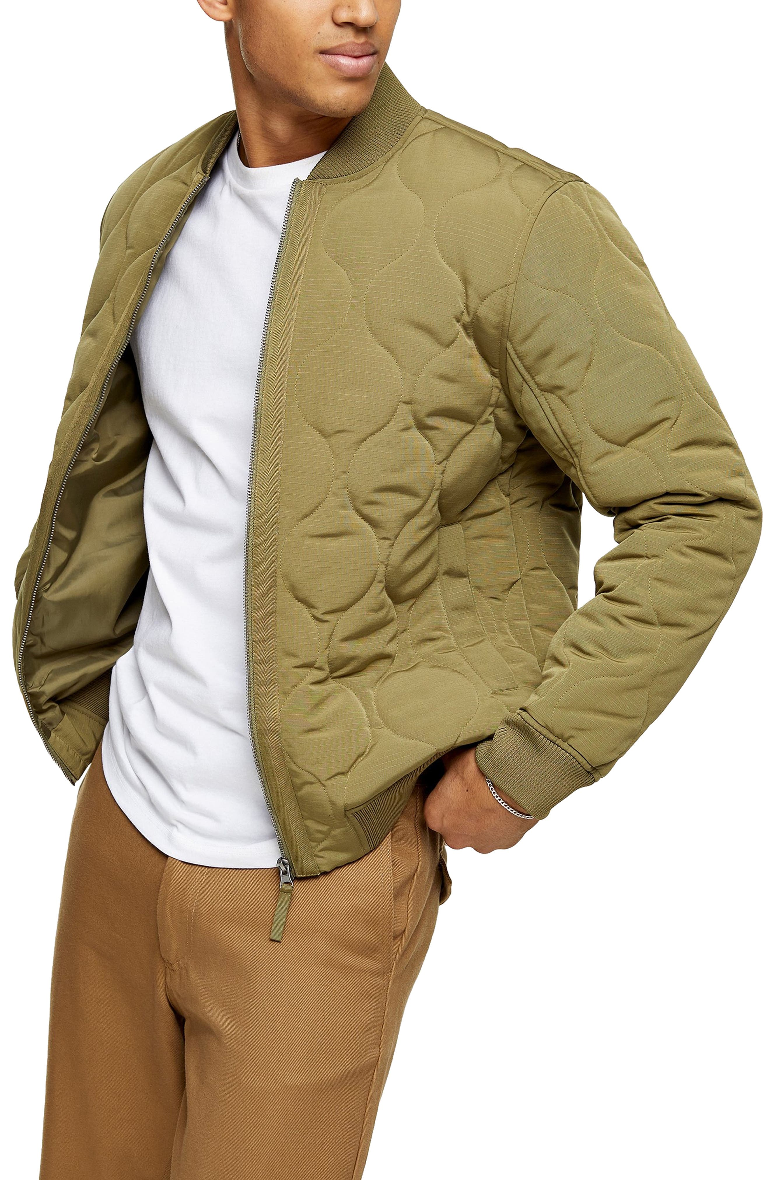 Puffed quilting textures this sleek and sporty bomber punctuated with ribbed trim. Style Name: Topman Jake Classic Bomber Jacket. Style Number: 6092012. Available in stores.