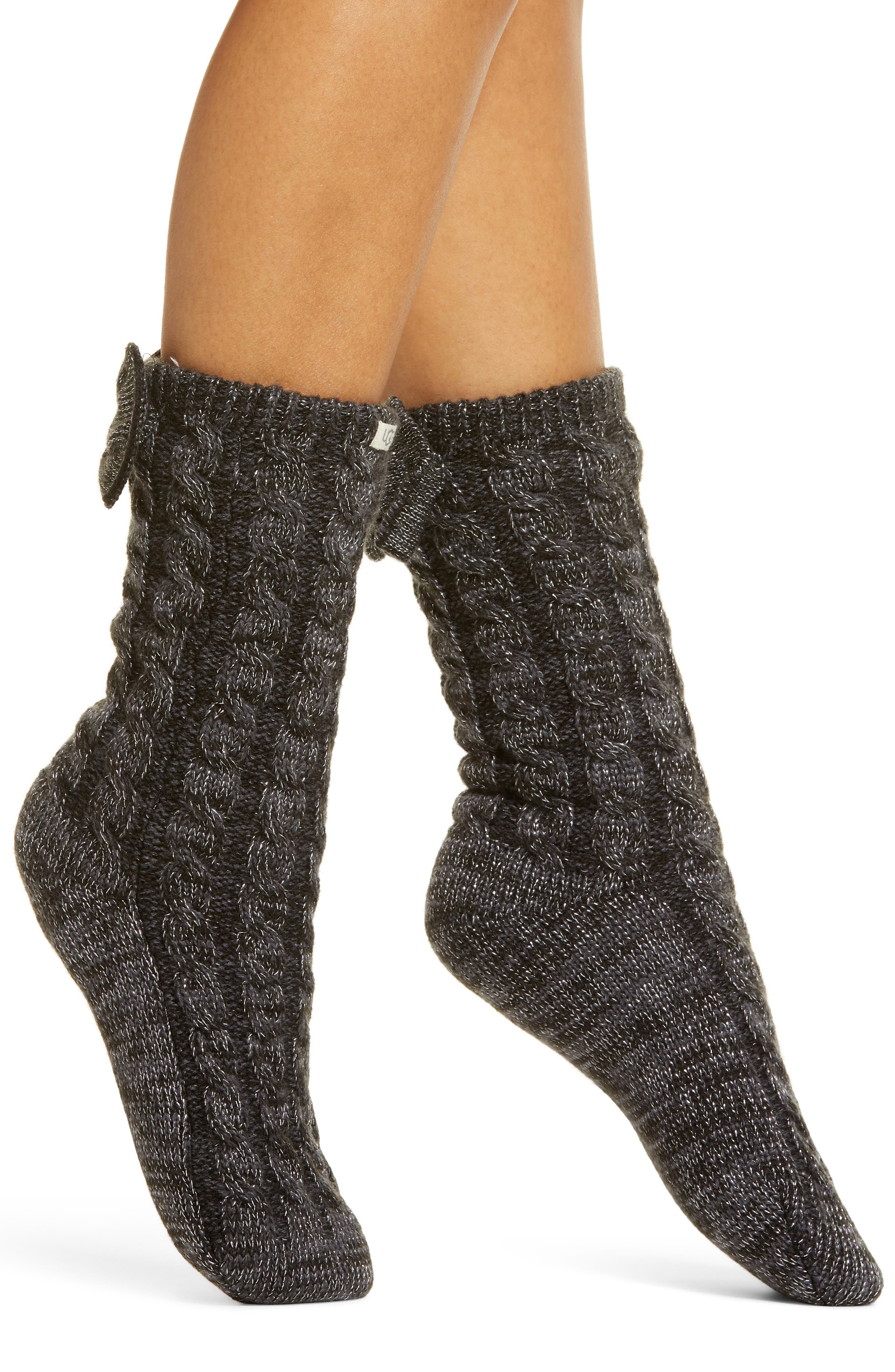 Chunky cables texture the exterior of these cozy crew socks enhanced by bow-set cuffs and plush fleece lining. Style Name: UGG Laila Bow Fleece Lined Socks. Style Number: 6060108 1. Available in stores.