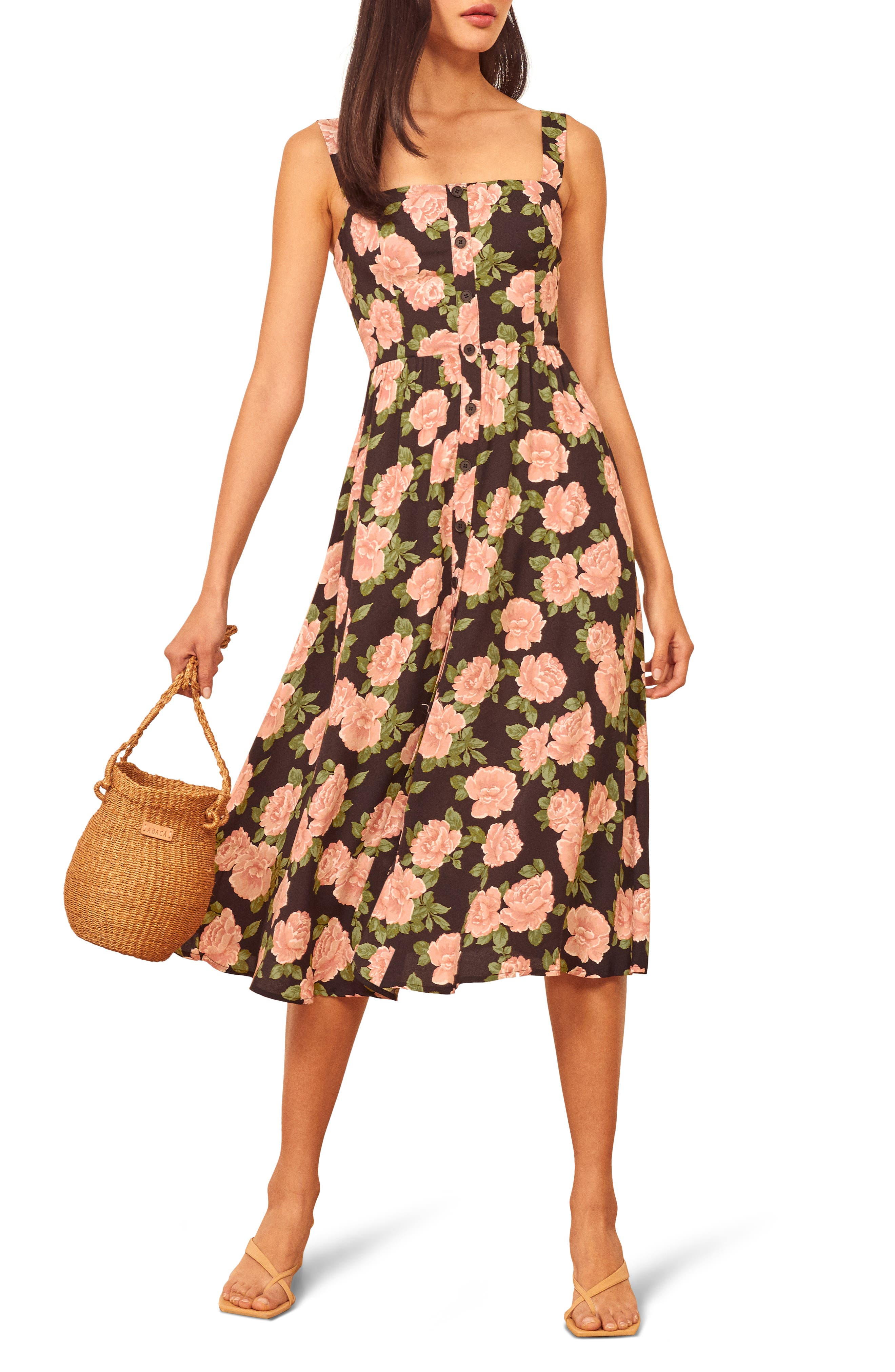 This pretty sundress charms with its rosy print, open neckline and flowy midi silhouette. Style Name: Reformation Saltillo Floral Print Midi Sundress. Style Number: 6054649. Available in stores.