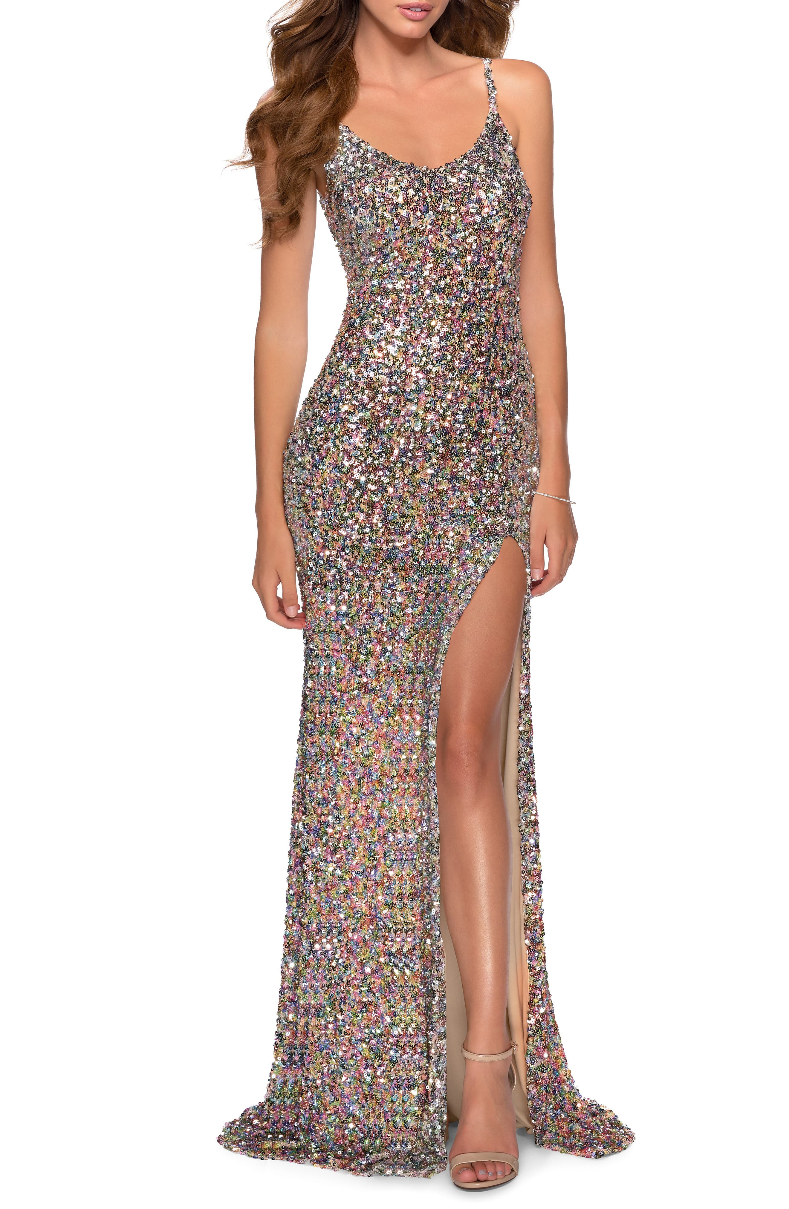 Light up every room in a rainbow of shimmer wearing this multicolored-sequin gown shaped a scooped neck, an alluring slit and a floor-sweeping skirt. Style Name: La Femme Multicolor Sequin Gown. Style Number: 5961583. Available in stores.