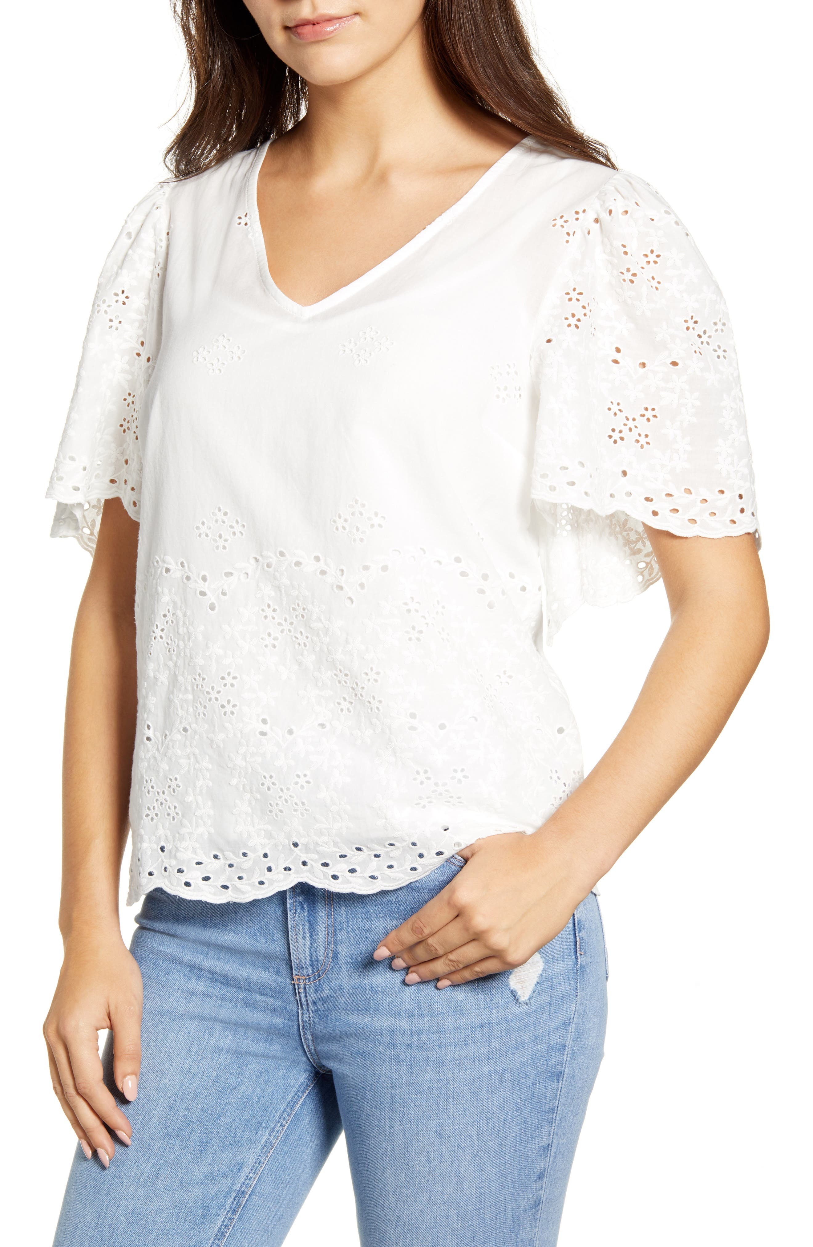 Charming eyelet adds romance to a cool V-neck top framed with fluttery sleeves and finished with a scalloped hem. Style Name: Bobeau Nyla Flutter Sleeve Cotton Eyelet Top. Style Number: 6030001. Available in stores.