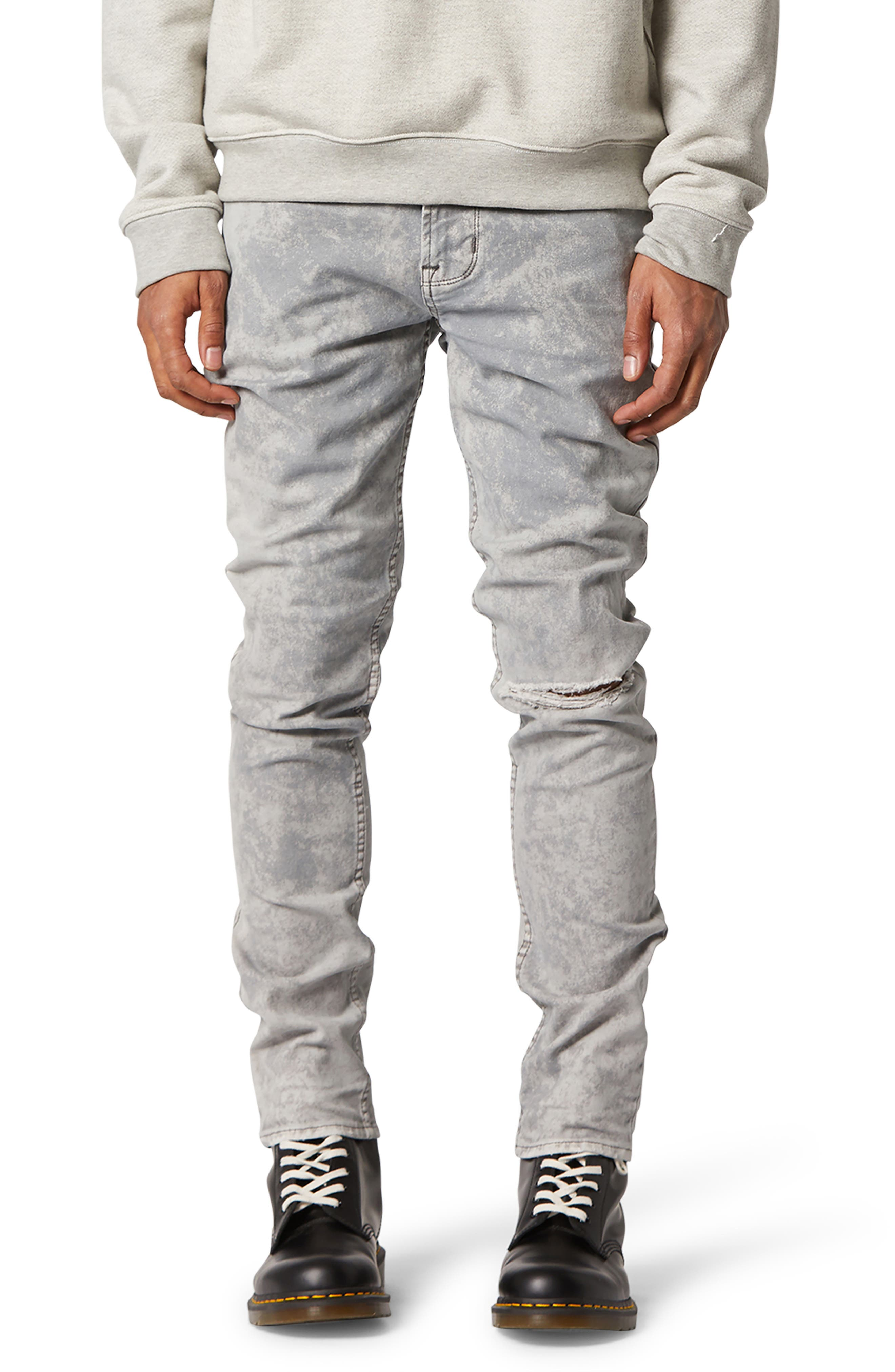 Rips, wrinkles and hard evidence of an acid fight bring unexplainable history to true skinny-fit jeans that pair mid-rise comfort with snug, tapered legs. Style Name: Hudson Jeans Axl Ripped Skinny Jeans (Grey Acid). Style Number: 6030638. Available in stores.