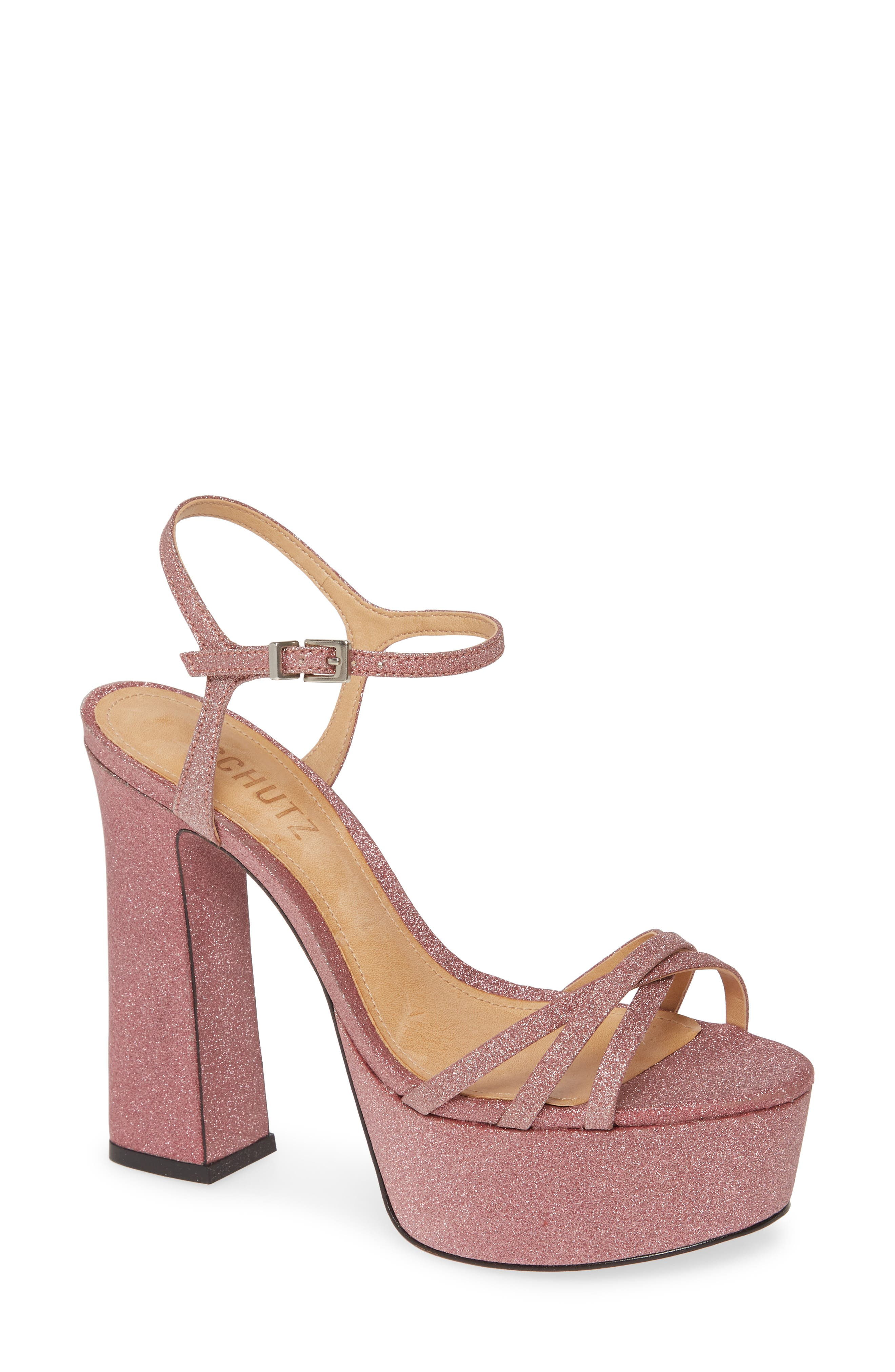 A platform sandal with some powerful curves features a sky-high heel and glitter that doesn\'t quit, sparkling from the ankle strap to the sole. Style Name: Schutz Landrie Glitter Platform Sandal (Women). Style Number: 5911288. Available in stores.