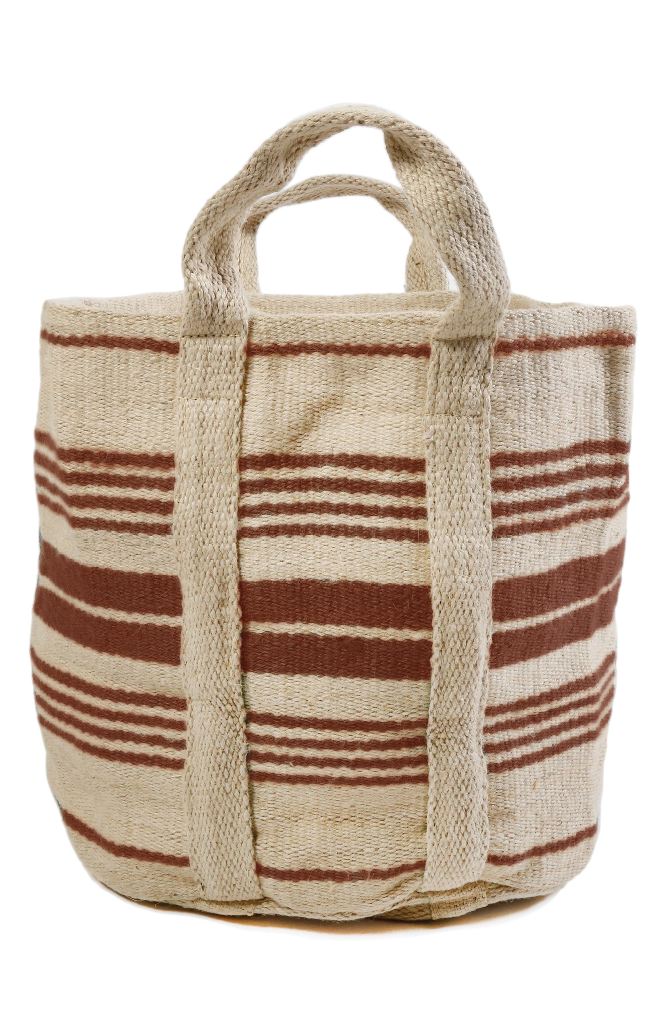 Hand-loomed in sturdy cotton, this stylish striped basket makes a beautiful organizer for magazines, linens, toys and more. Style Name: Pom Pom At Home Savannah Handwoven Basket. Style Number: 5857460. Available in stores.