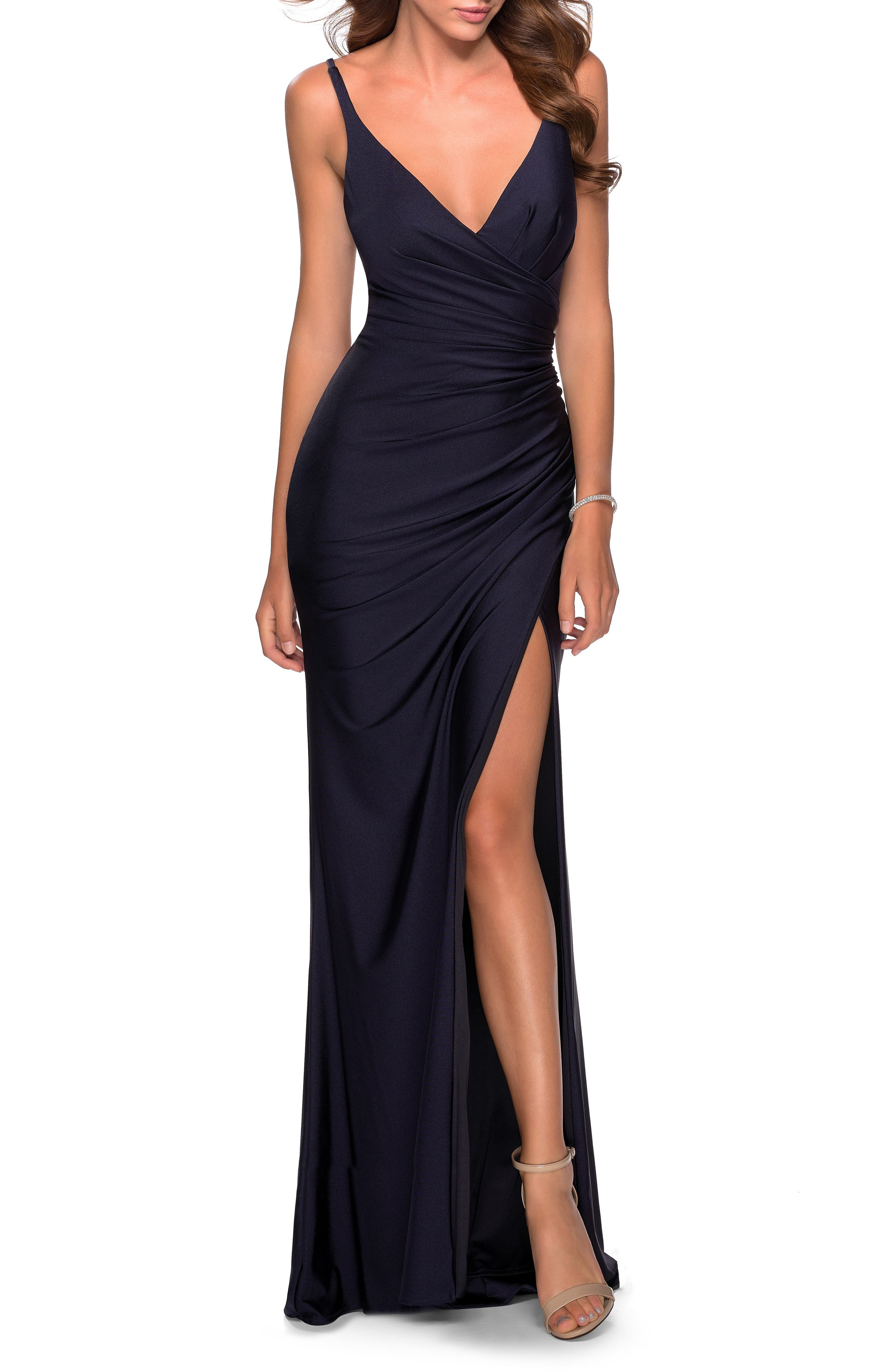 Make a leg-flaunting entrance, a back-baring exit and a memorable impression in between in this soft jersey gown cut to show some skin and ruched to flatter. Style Name: La Femme Ruched Jersey Gown. Style Number: 6024970. Available in stores.